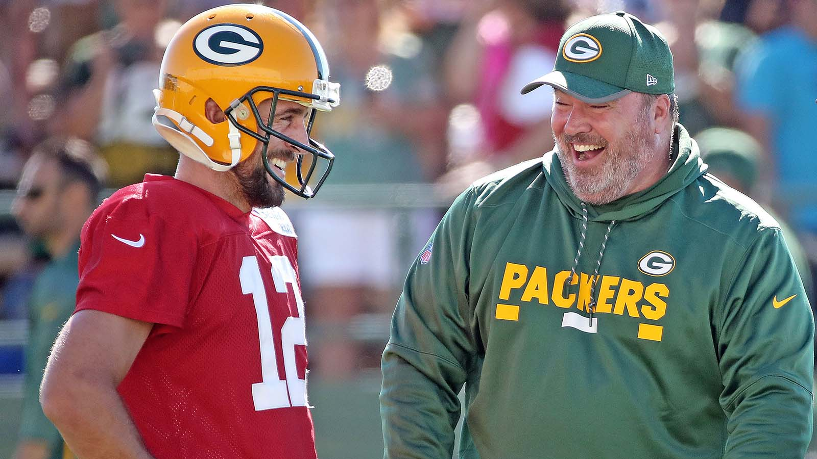 June 29, 2017; Ashwabenon, WI, USA; Green Bay Packers quarterback Aaron Rodgers (12) talks with head coach Mike McCarthy during Green Bay Packers Training Camp at Ray Nitschke Field. Mandatory credit: Jim Matthews-USA TODAY NETWORK