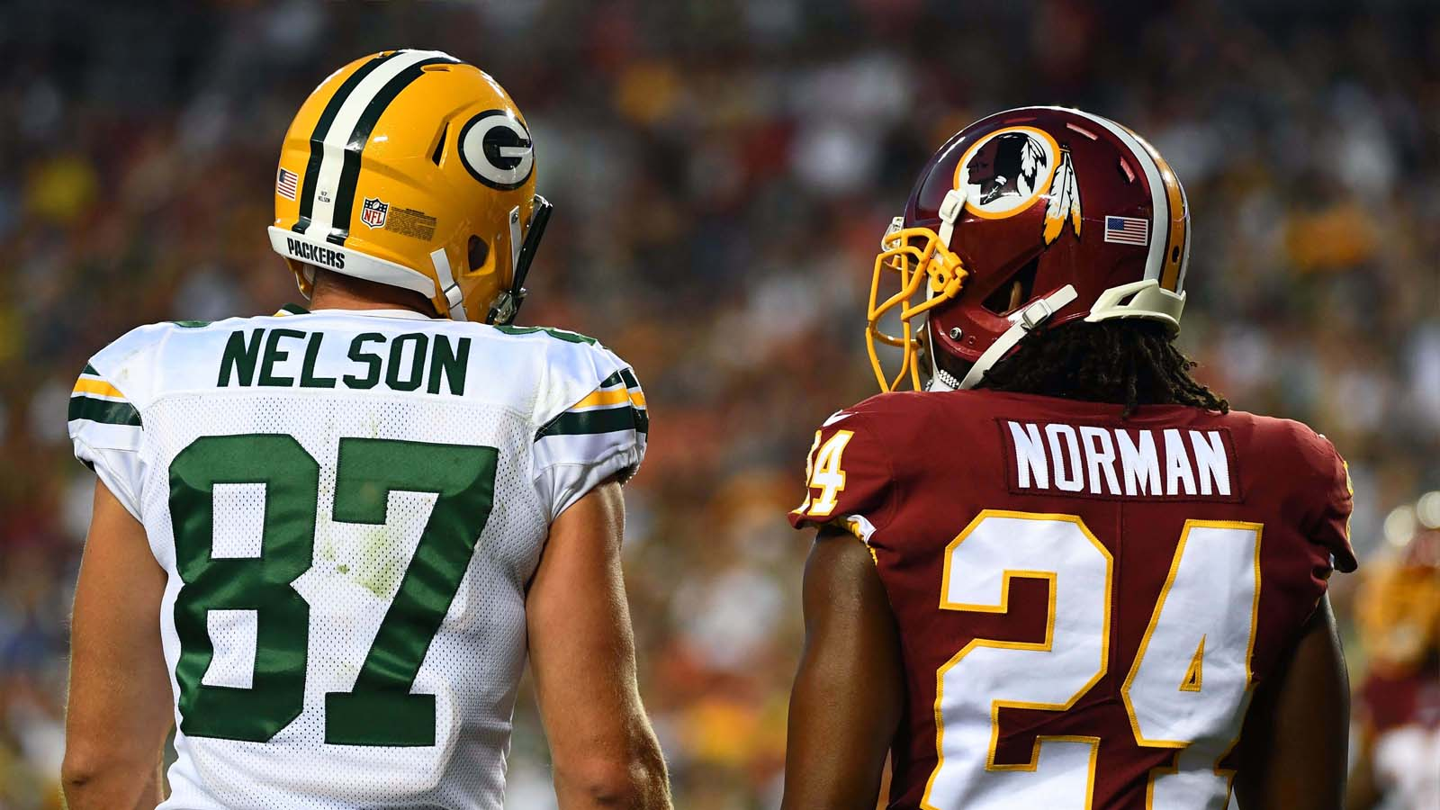 Green Bay Packers wide receiver Jordy Nelson talks with Washington Redskins cornerback Josh Norman during the first half at FedEx Field in Landover, Md., Saturday, Aug. 19, 2017.