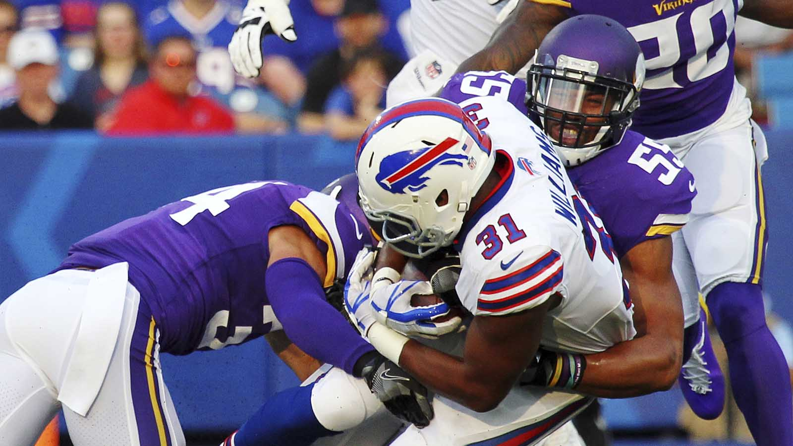 Minnesota Vikings outside linebacker Anthony Barr (55) and Bishop Sankey (left) tackle the Buffalo Bills' Jonathan Williams during the first half of a preseason game Thursday, Aug. 10, 2017, in Orchard Park, N.Y.