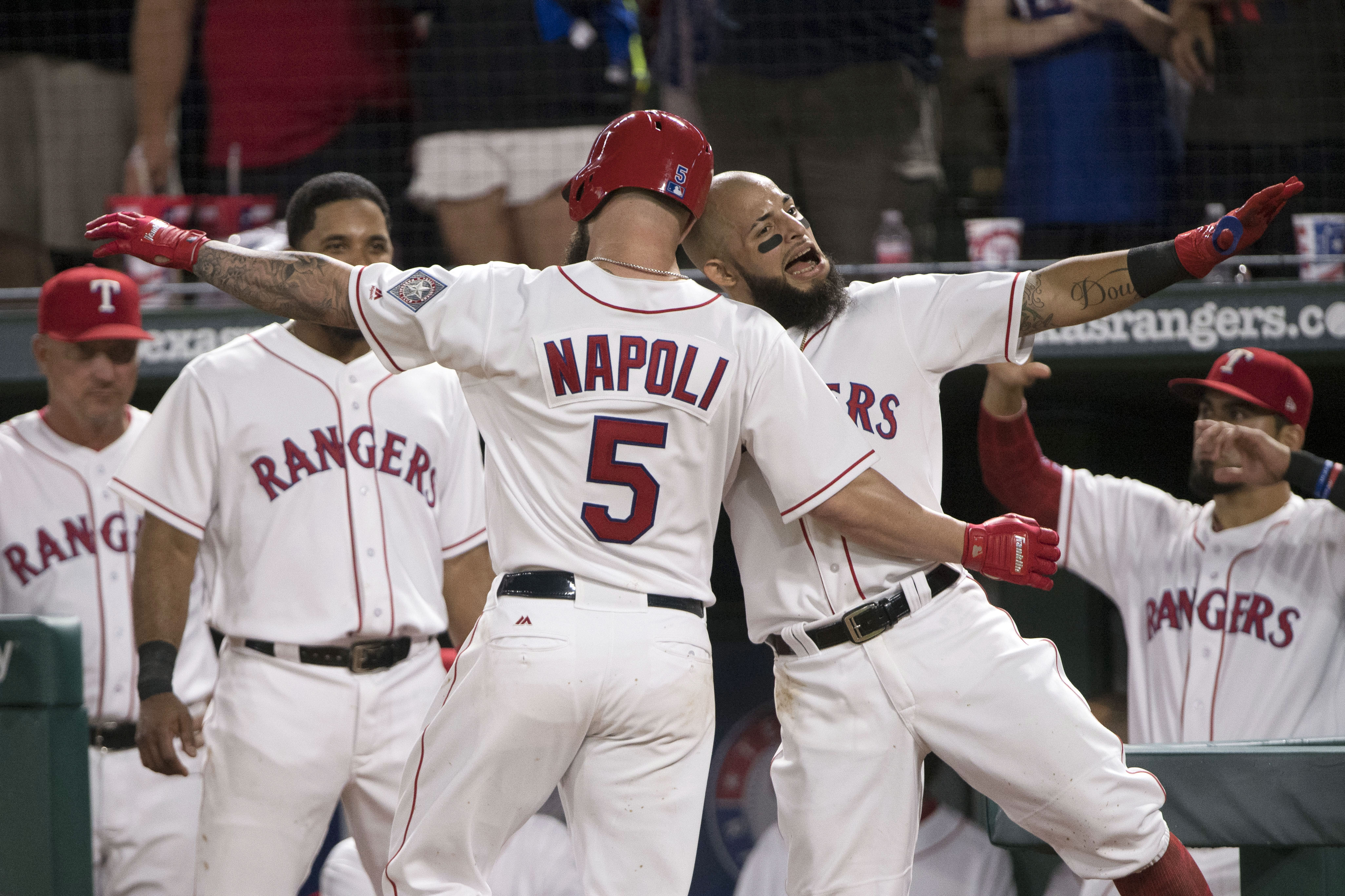 Aug 12, 2017; Arlington, TX, USA; Texas Rangers first baseman Mike Napoli (5) and second baseman Rougned Odor (12) celebrate Naopli's home run during the fourth inning against the Houston Astros at Globe Life Park in Arlington. Mandatory Credit: Jerome Miron-USA TODAY Sports