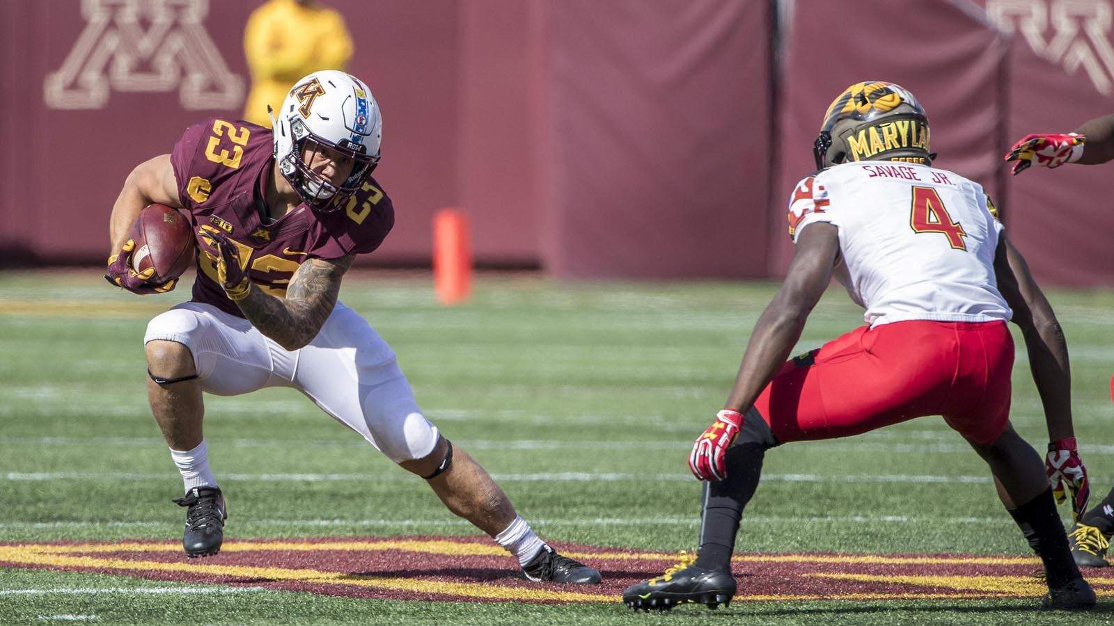 Sep 30, 2017; Minneapolis, MN, USA; Minnesota Golden Gophers running back Shannon Brooks (23) rushes with ball past Maryland Terrapins defensive back Darnell Savage Jr. (4) in the first half at TCF Bank Stadium. Mandatory Credit: Jesse Johnson-USA TODAY Sports