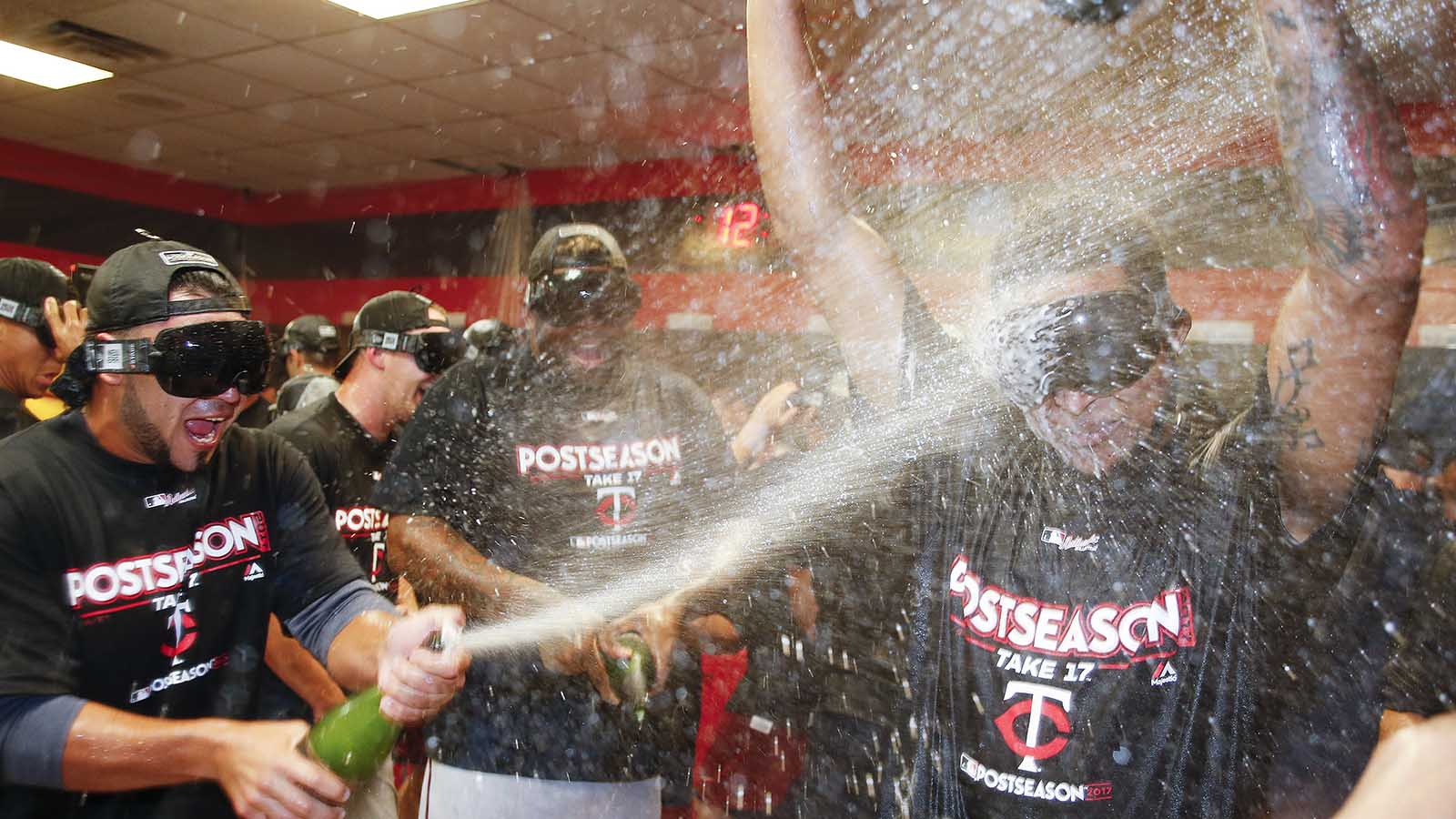 The Minnesota Twins celebrate early Thursday, Sept. 28, 2017, in Cleveland. The Twins earned an AL wild-card berth after the Los Angeles Angels lost to the Chicago White Sox. The Twins had lost 4-2 to the Cleveland Indians on Wednesday night. (AP Photo/Ron Schwane)