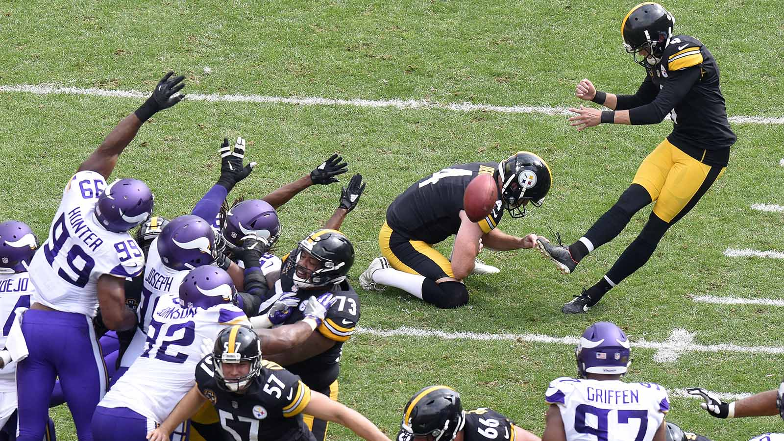 Pittsburgh Steelers kicker Chris Boswell (9) kicks a field goal out of the hold by Jordan Berry (4) during the second half of an NFL football game against the Minnesota Vikings in Pittsburgh, Sunday, Sept. 17, 2017. (AP Photo/Don Wright)