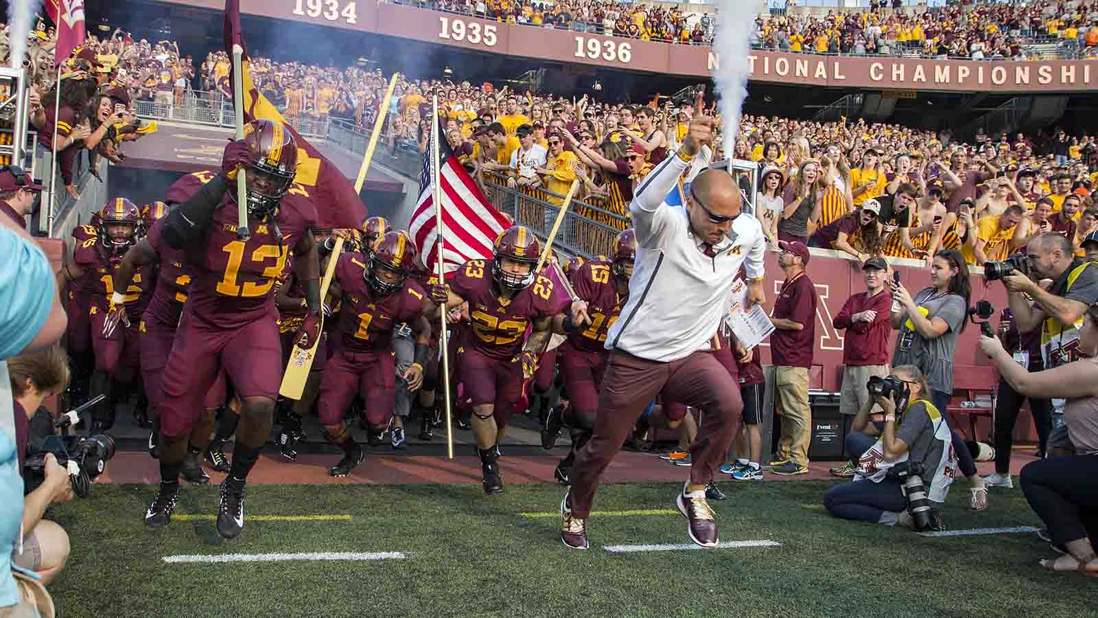 Aug 31, 2017; Minneapolis, MN, USA;  Minnesota Golden Gophers head coach P.J. Fleck leads his team onto the field before a game against the Buffalo Bulls at TCF Bank Stadium. Mandatory Credit: Jesse Johnson-USA TODAY Sports