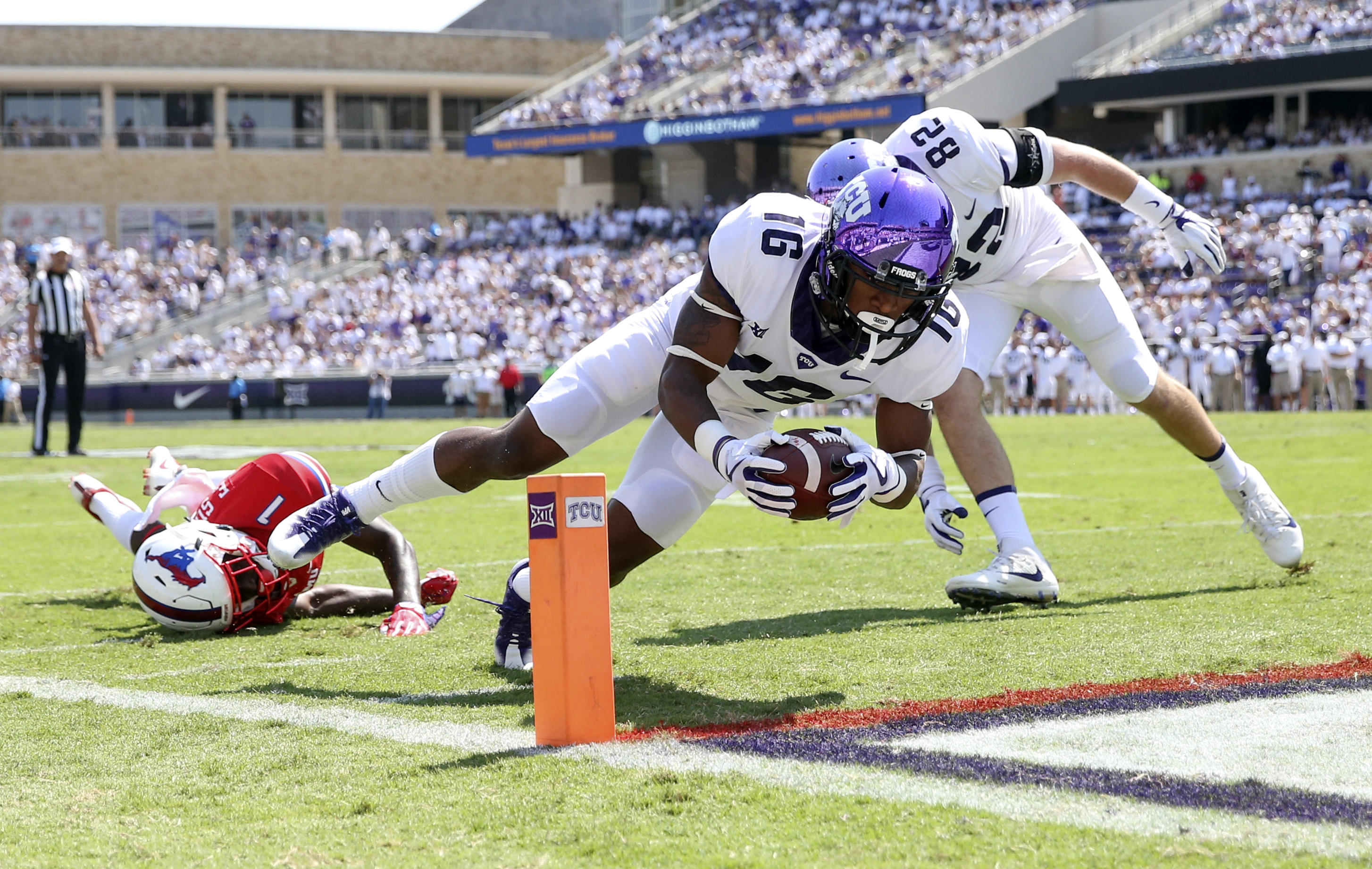 Sep 16, 2017; Fort Worth, TX, USA; TCU Horned Frogs running back Kenedy Snell (16) dives for a touchdown past Southern Methodist Mustangs cornerback Eric Sutton (1) during the first quarter at Amon G. Carter Stadium. Mandatory Credit: Kevin Jairaj-USA TODAY Sports