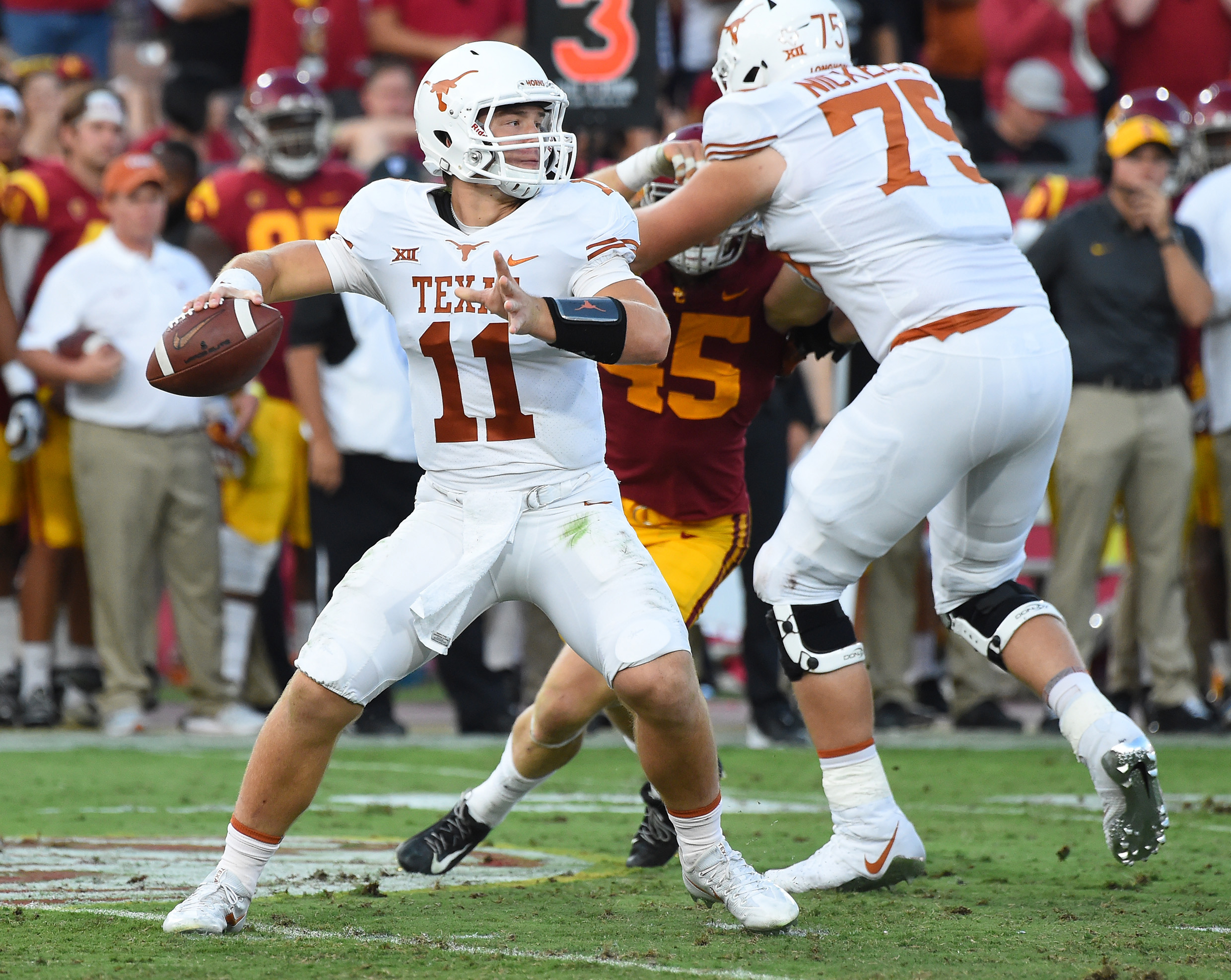 Sep 16, 2017; Los Angeles, CA, USA;   Texas Longhorns quarterback Sam Ehlinger (11) sets to pass in the second half of the game against the USC Trojans at Los Angeles Memorial Coliseum. Mandatory Credit: Jayne Kamin-Oncea-USA TODAY Sports