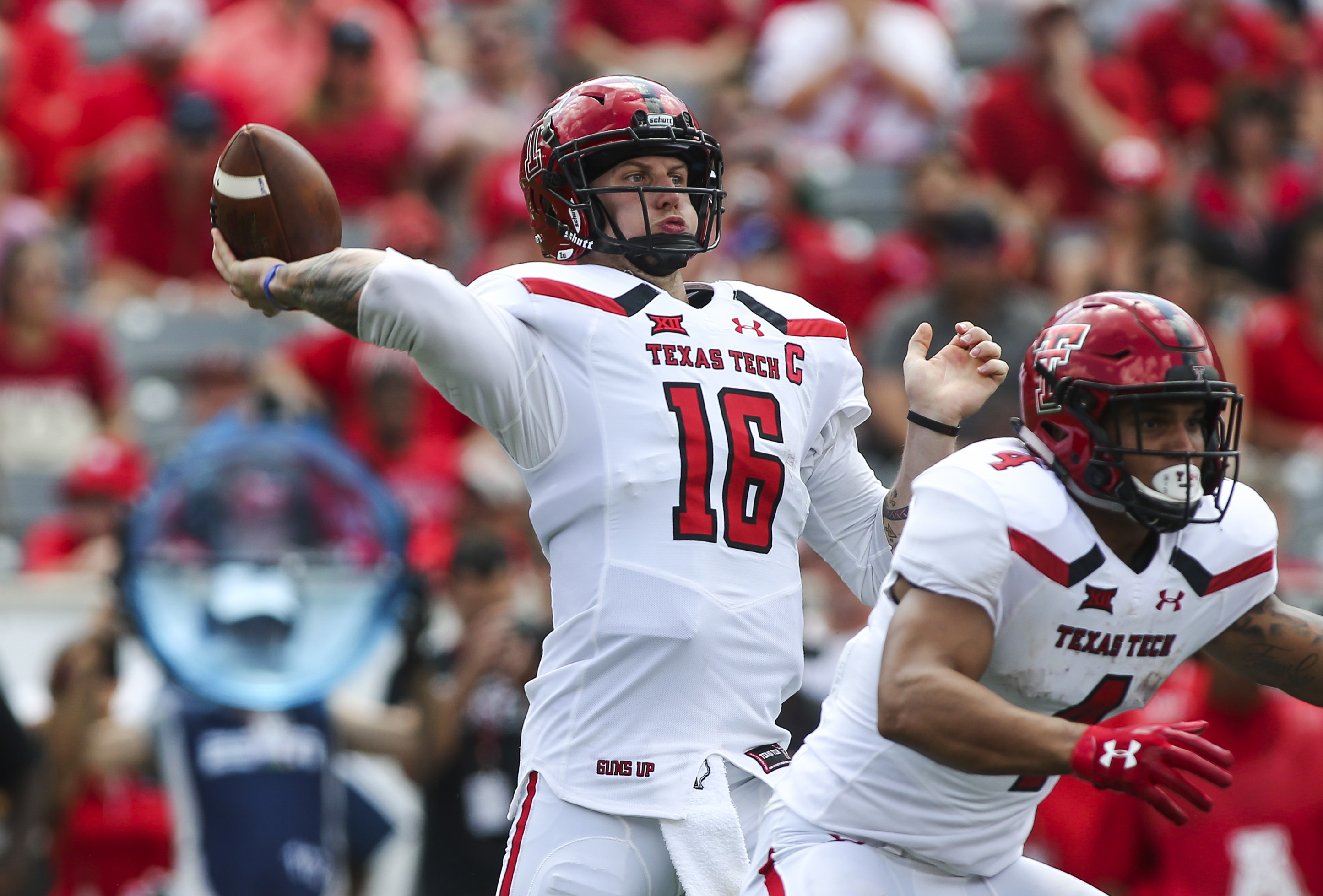Sep 23, 2017; Houston, TX, USA; Texas Tech Red Raiders quarterback Nic Shimonek (16) throws a pass for a touchdown during the third quarter against the Houston Cougars at TDECU Stadium. Mandatory Credit: Troy Taormina-USA TODAY Sports