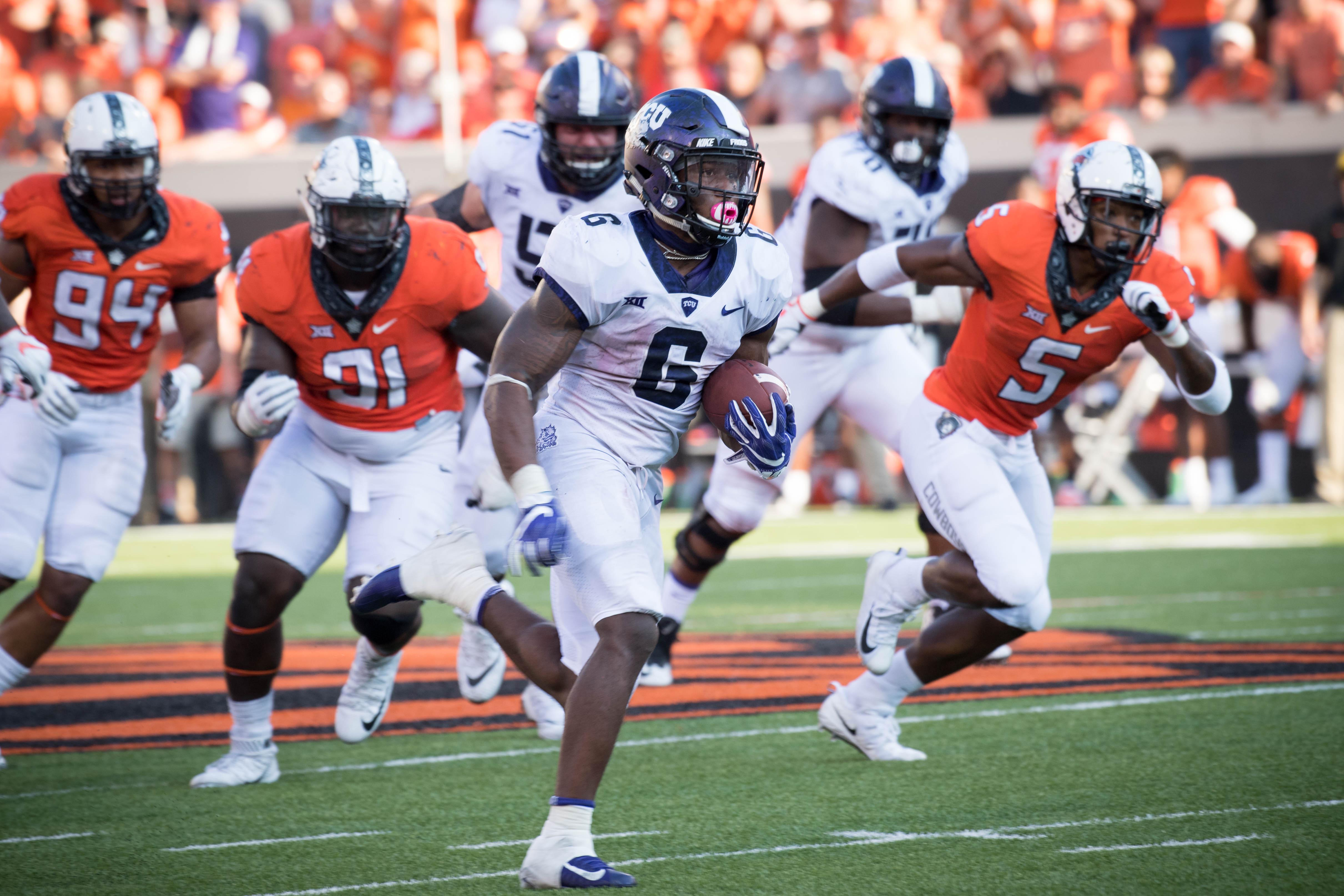 Sep 23, 2017; Stillwater, OK, USA; TCU Horned Frogs running back Darius Anderson (6) runs the ball for a touchdown during the second half at Boone Pickens Stadium. Mandatory Credit: Rob Ferguson-USA TODAY Sports