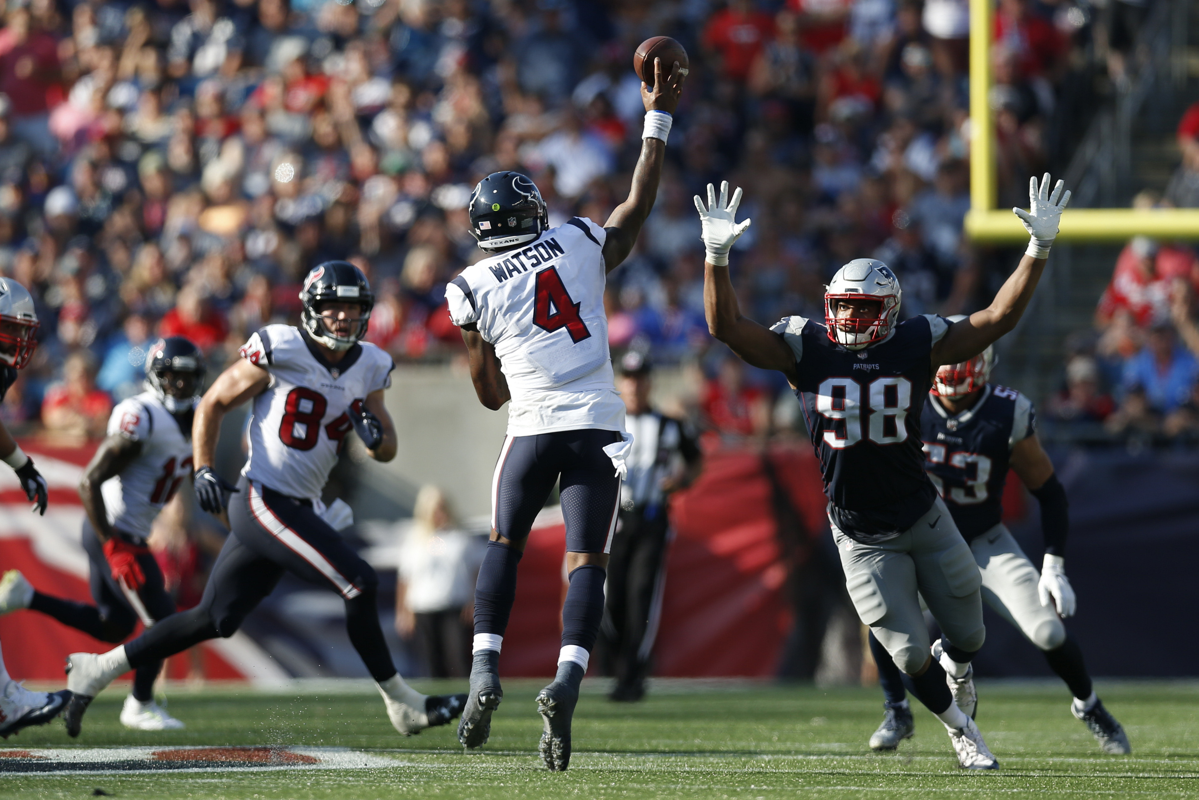 Sep 24, 2017; Foxborough, MA, USA; Houston Texans quarterback Deshaun Watson (4) throws a pass while pressured by New England Patriots defensive end Trey Flowers (98) during the second half at Gillette Stadium. Mandatory Credit: Greg M. Cooper-USA TODAY Sports