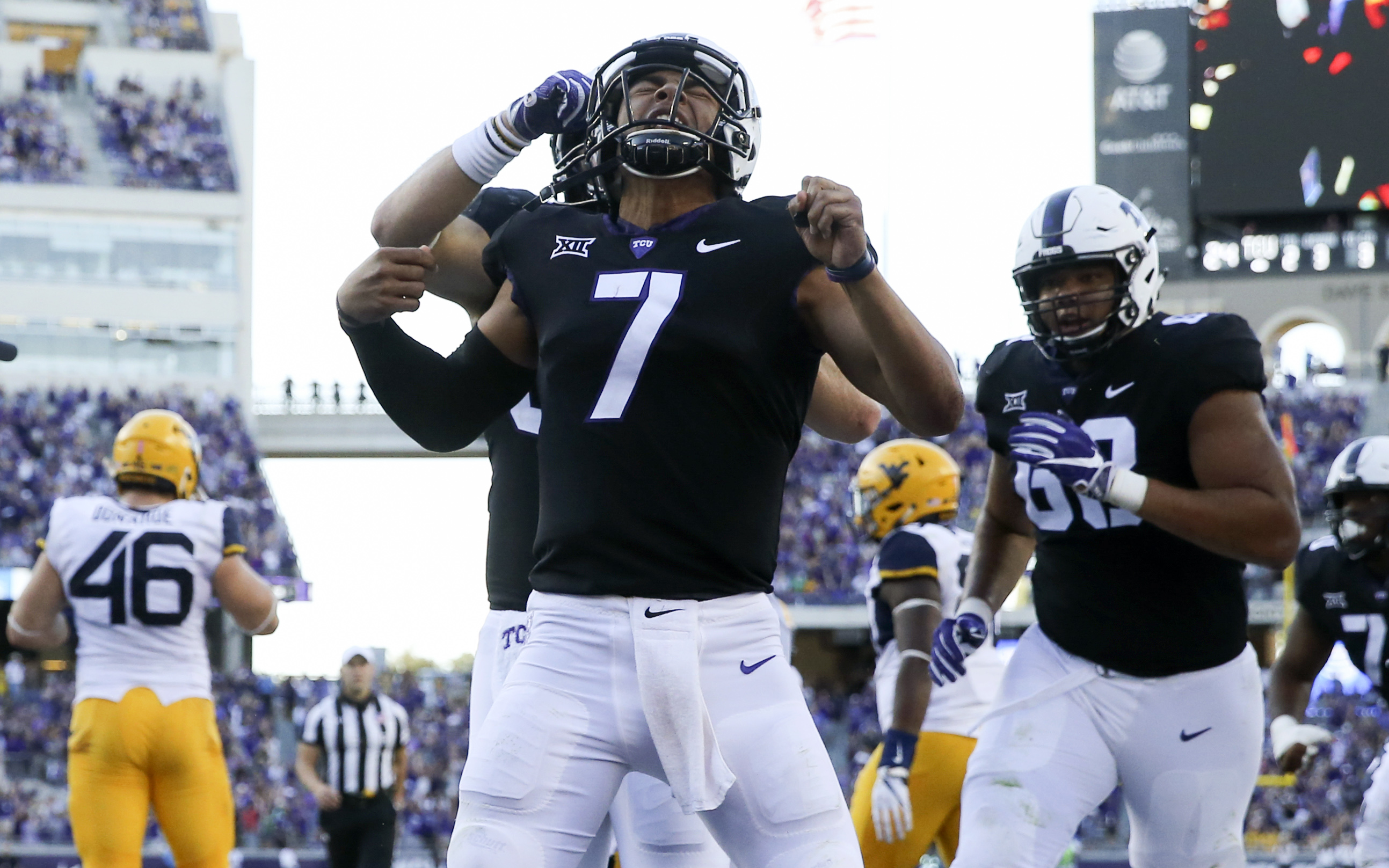 Oct 7, 2017; Fort Worth, TX, USA; TCU Horned Frogs quarterback Kenny Hill (7) celebrates with teammates after scoring the game-winning touchdown during the fourth quarter against the West Virginia Mountaineers at Amon G. Carter Stadium. Mandatory Credit: Kevin Jairaj-USA TODAY Sports