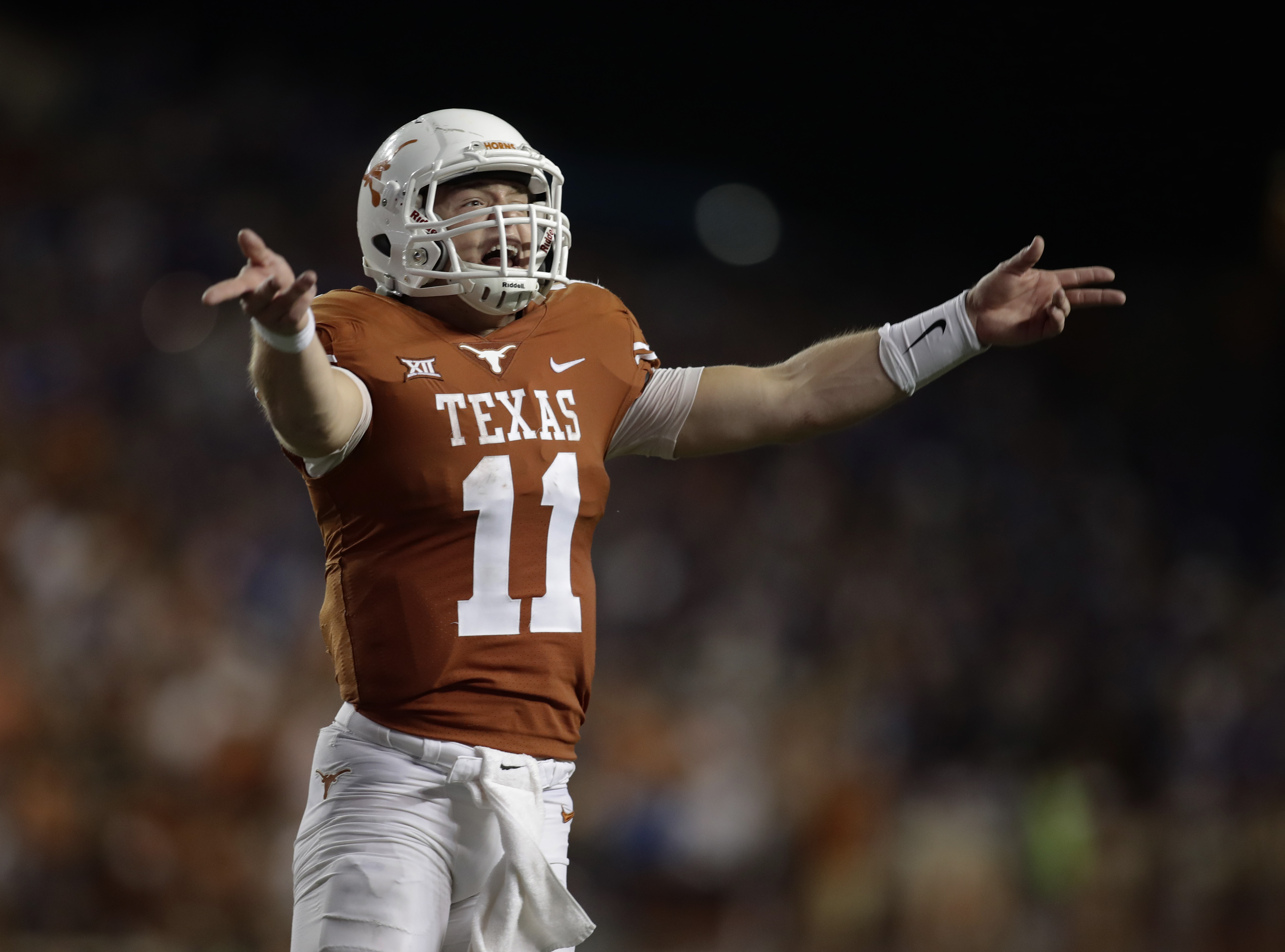 Oct 7, 2017; Austin, TX, USA; Texas Longhorns quarterback Sam Ehlinger (11) celebrates a touchdown against the Kansas State Wildcats at Darrell K Royal-Texas Memorial Stadium. Texas won 40-35 in double overtime. Mandatory Credit: Erich Schlegel-USA TODAY Sports
