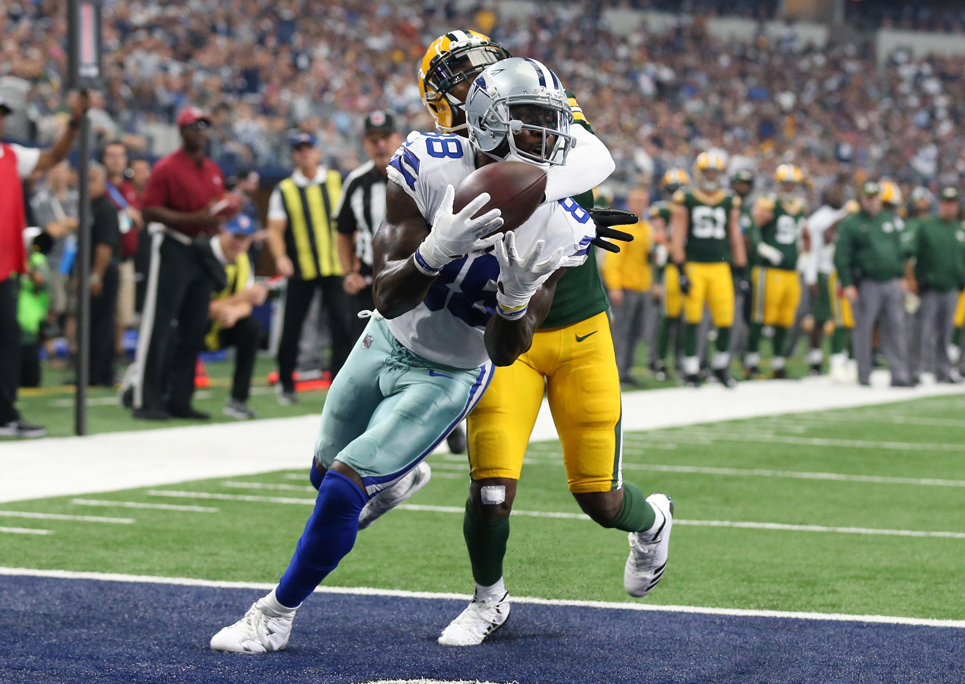 Oct 8, 2017; Arlington, TX, USA; Dallas Cowboys receiver Dez Bryant (88) makes a second quarter touchdown reception against Green Bay Packers cornerback Damarious Randall (23) at AT&T Stadium. Mandatory Credit: Matthew Emmons-USA TODAY Sports