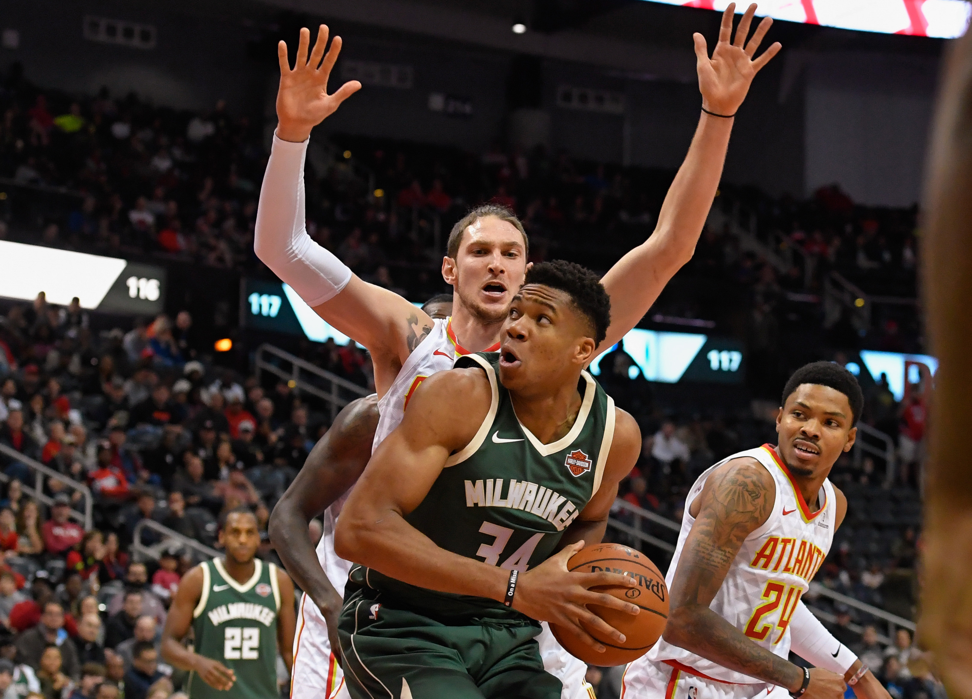 Oct 29, 2017; Atlanta, GA, USA; Milwaukee Bucks forward Giannis Antetokounmpo (34) works against the defense of Atlanta Hawks forward Mike Muscala (31) during the first half at Philips Arena. Mandatory Credit: Dale Zanine-USA TODAY Sports