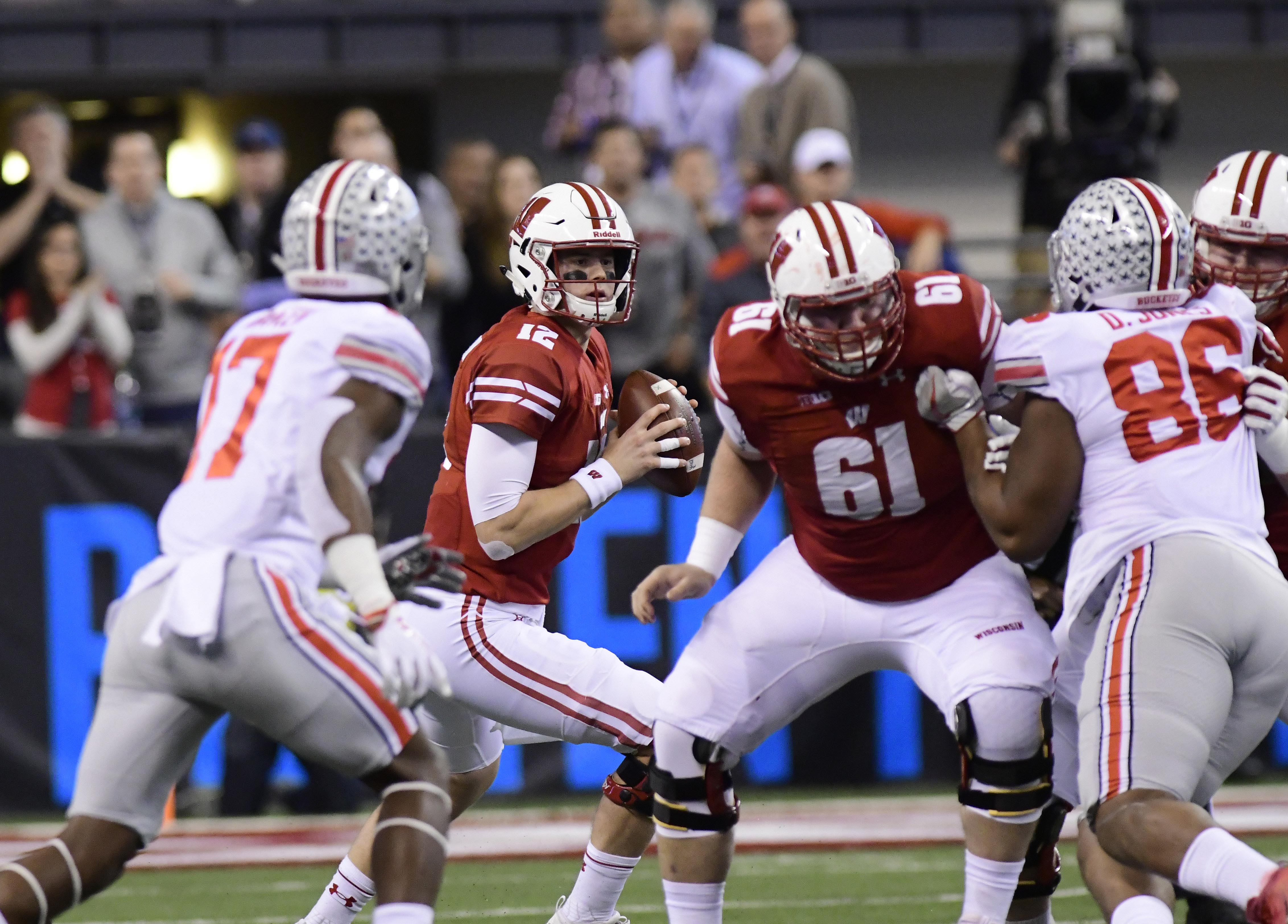 Dec 2, 2017; Indianapolis, IN, USA; Wisconsin Badger quarterback Alex Hornibrook (12) drops back to pass in the first quarter against Ohio State in the Big Ten championship game at Lucas Oil Stadium. Mandatory Credit: Thomas J. Russo-USA TODAY Sports