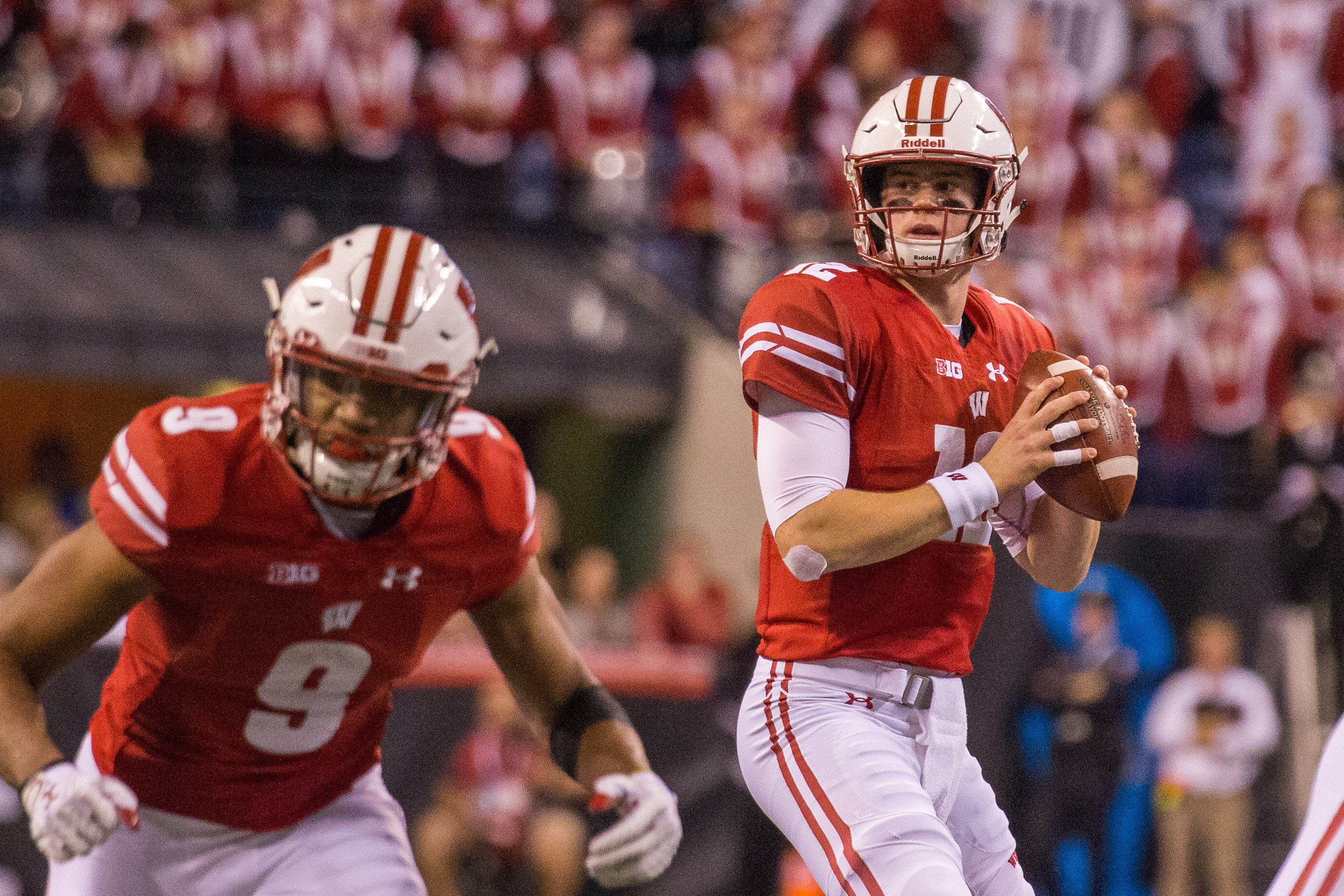 Dec 2, 2017; Indianapolis, IN, USA; Wisconsin Badgers quarterback Alex Hornibrook (12) drops back to pass the ball in the first half against the Ohio State Buckeyes in the Big Ten championship game at Lucas Oil Stadium. Mandatory Credit: Trevor Ruszkowski-USA TODAY Sports
