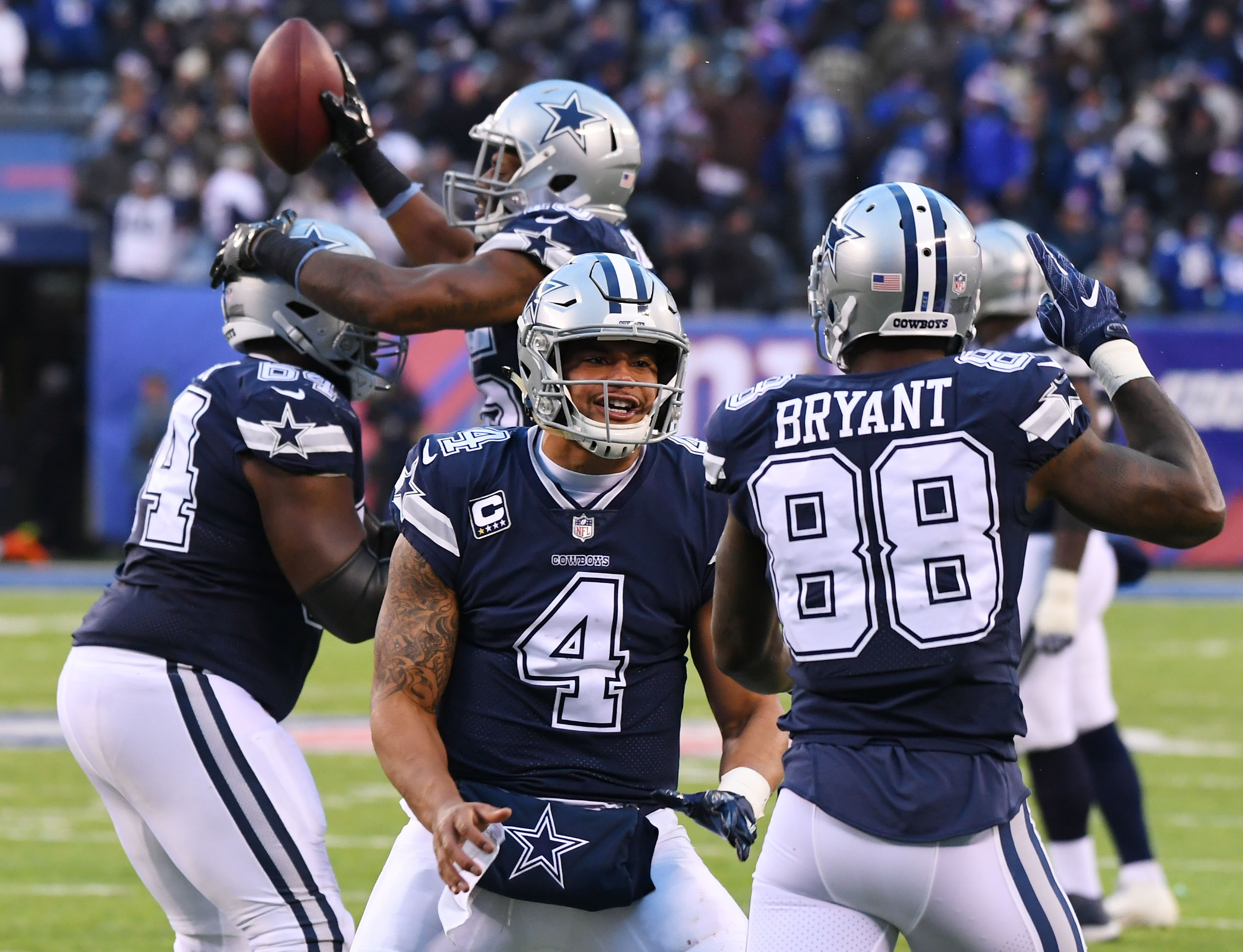 (EDITORS NOTE: caption correction) Dec 10, 2017; East Rutherford, NJ, USA; Dallas Cowboys quarterback Dak Prescott (4) and wide receiver Dez Bryant (88) celebrate a touchdown by running back Rod Smith (with ball) in the fourth quarter against the New York Giants during a NFL football game at MetLife Stadium. Mandatory Credit: Robert Deutsch-USA TODAY Sports