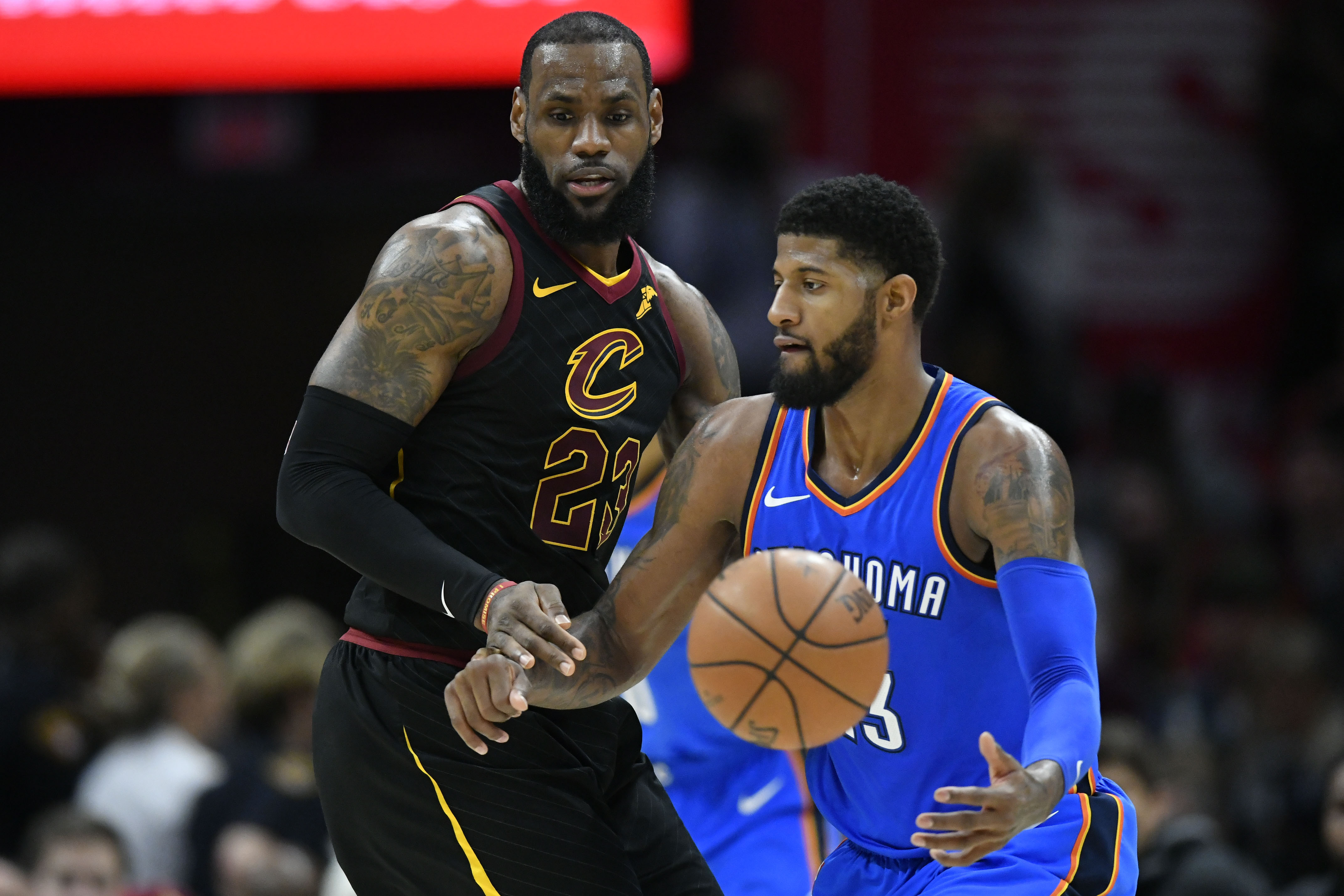 Jan 20, 2018; Cleveland, OH, USA; Cleveland Cavaliers forward LeBron James (23) defends Oklahoma City Thunder forward Paul George (13) in the third quarter at Quicken Loans Arena. Mandatory Credit: David Richard-USA TODAY Sports