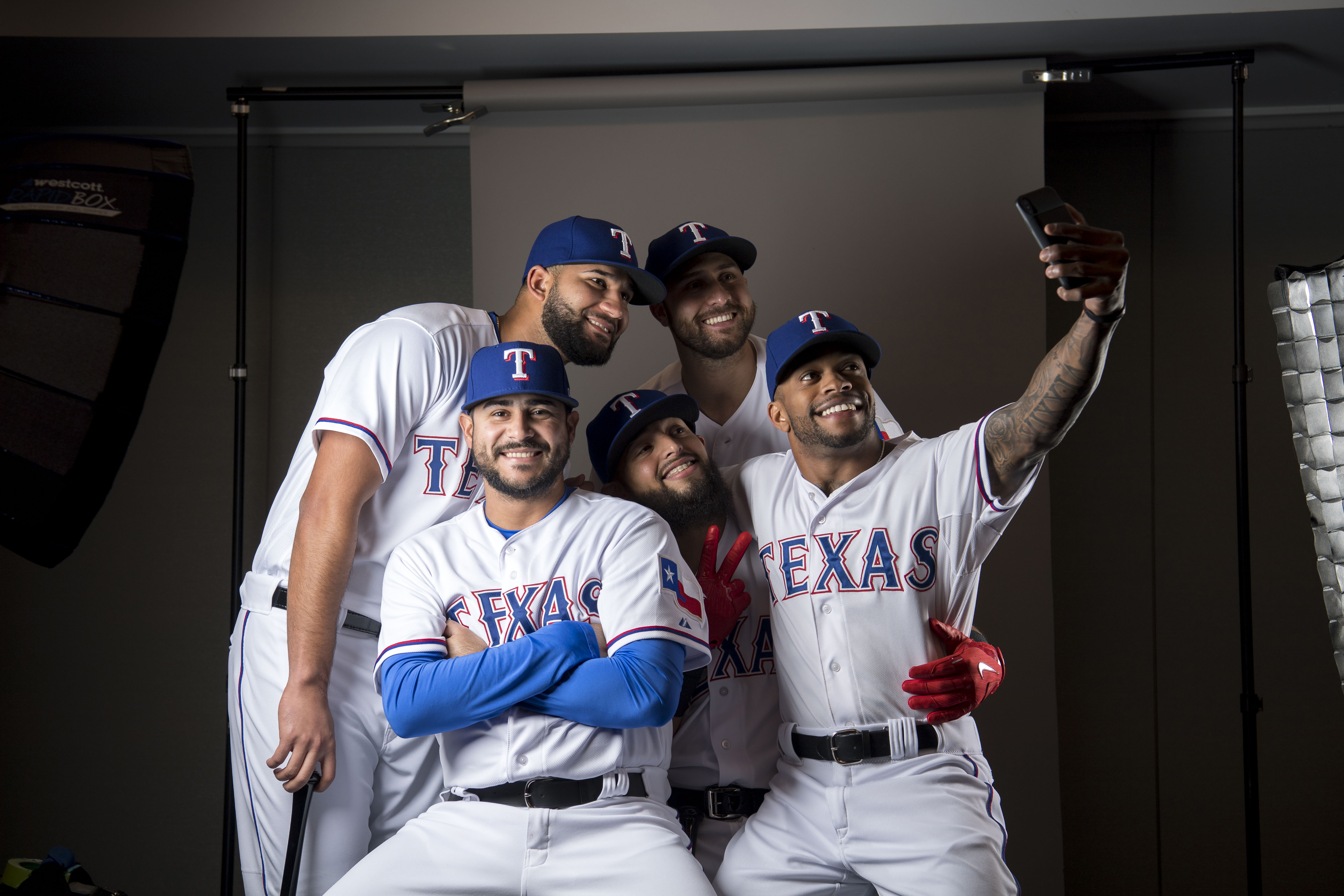 Feb 21, 2018; Surprise, AZ, USA; Texas Rangers starting pitcher Martin Perez (33) and right fielder Nomar Mazara (30) and second baseman Rougned Odor (12) and third baseman Joey Gallo (13) and left fielder Delino DeShields (3) pose together for a selfie photo during media day at Surprise Stadium. Mandatory Credit: Jerome Miron-USA TODAY Sports