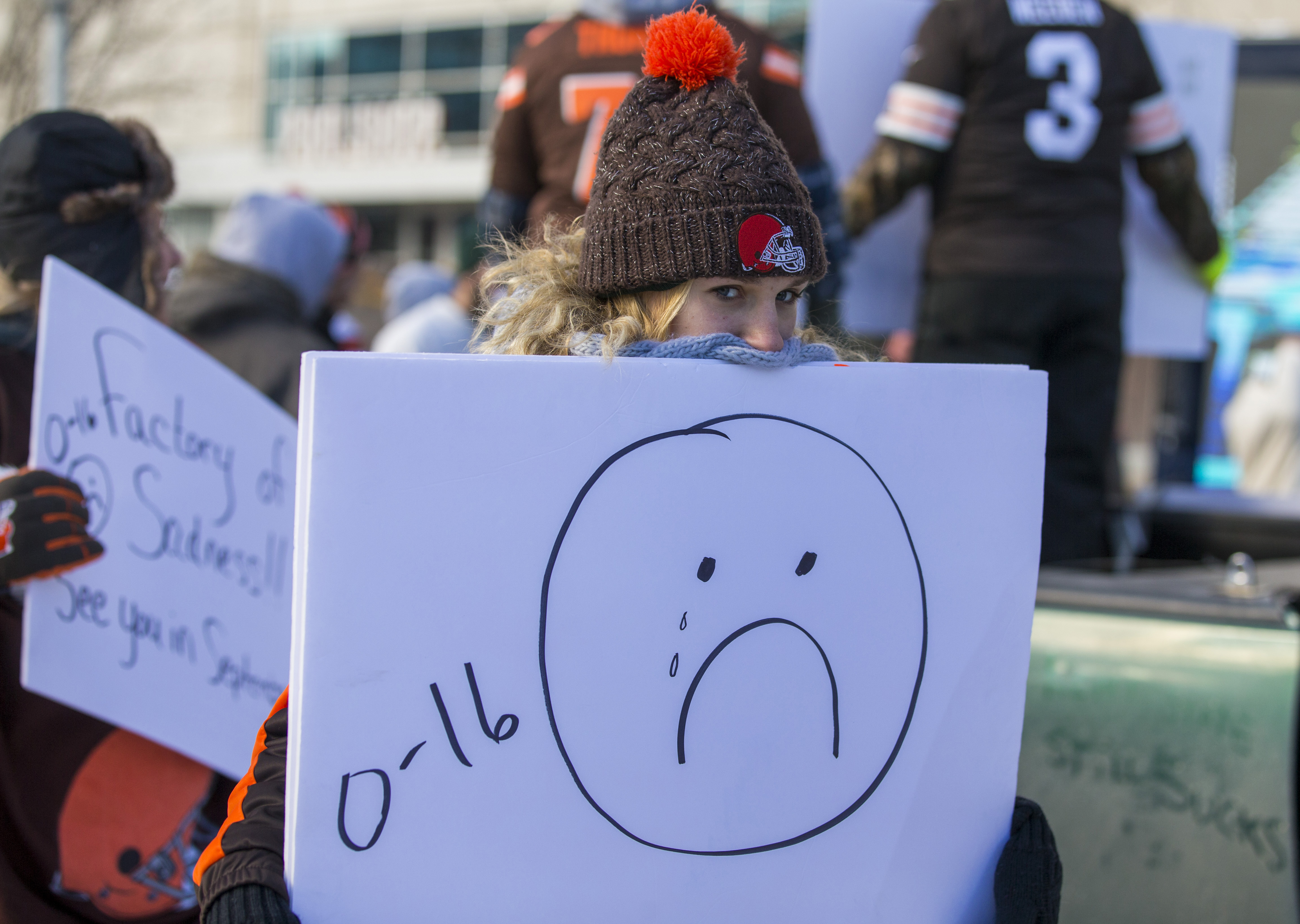 Jan 6, 2018; Cleveland, OH, USA; Noa Szylakowski from North Ridgeville, OH, carries a sign in the parade for the the Cleveland Browns 0-16 perfect season outside FirstEnergy Stadium. Mandatory Credit: Scott R. Galvin-USA TODAY Sports