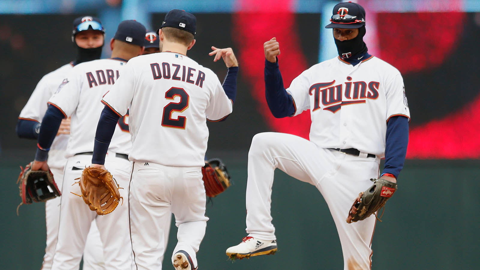 Minnesota Twins' Byron Buxton, right, celebrates with teammates after they defeated the Seattle Mariners in the Twins baseball home-opener Thursday, April 5, 2018, in Minneapolis.  (AP Photo/Jim Mone)