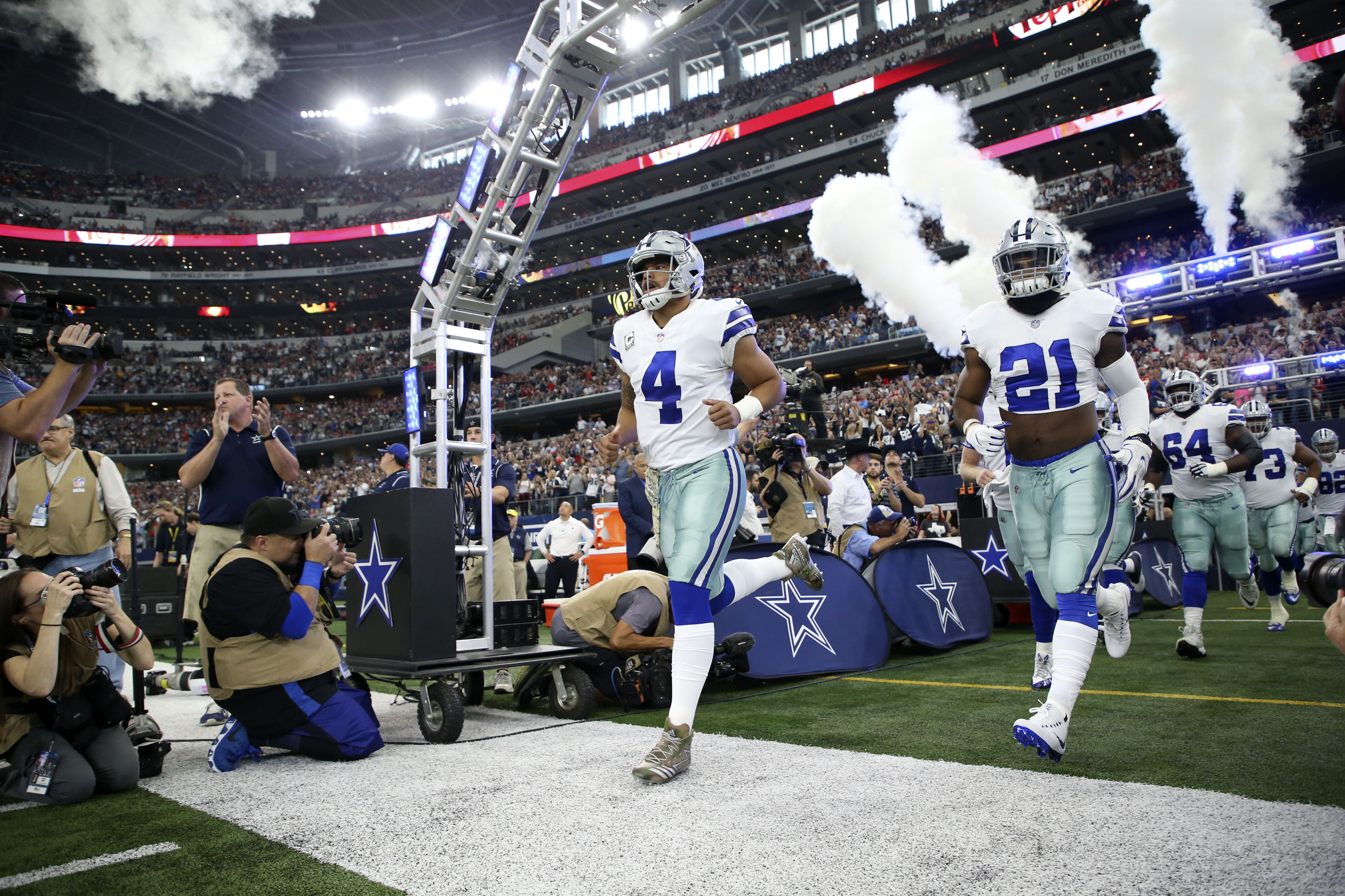 Nov 5, 2017; Arlington, TX, USA; Dallas Cowboys quarterback Dak Prescott (4) and running back Ezekiel Elliott (21) run onto the field before the game against the Kansas City Chiefs at AT&T Stadium. Mandatory Credit: Kevin Jairaj-USA TODAY Sports