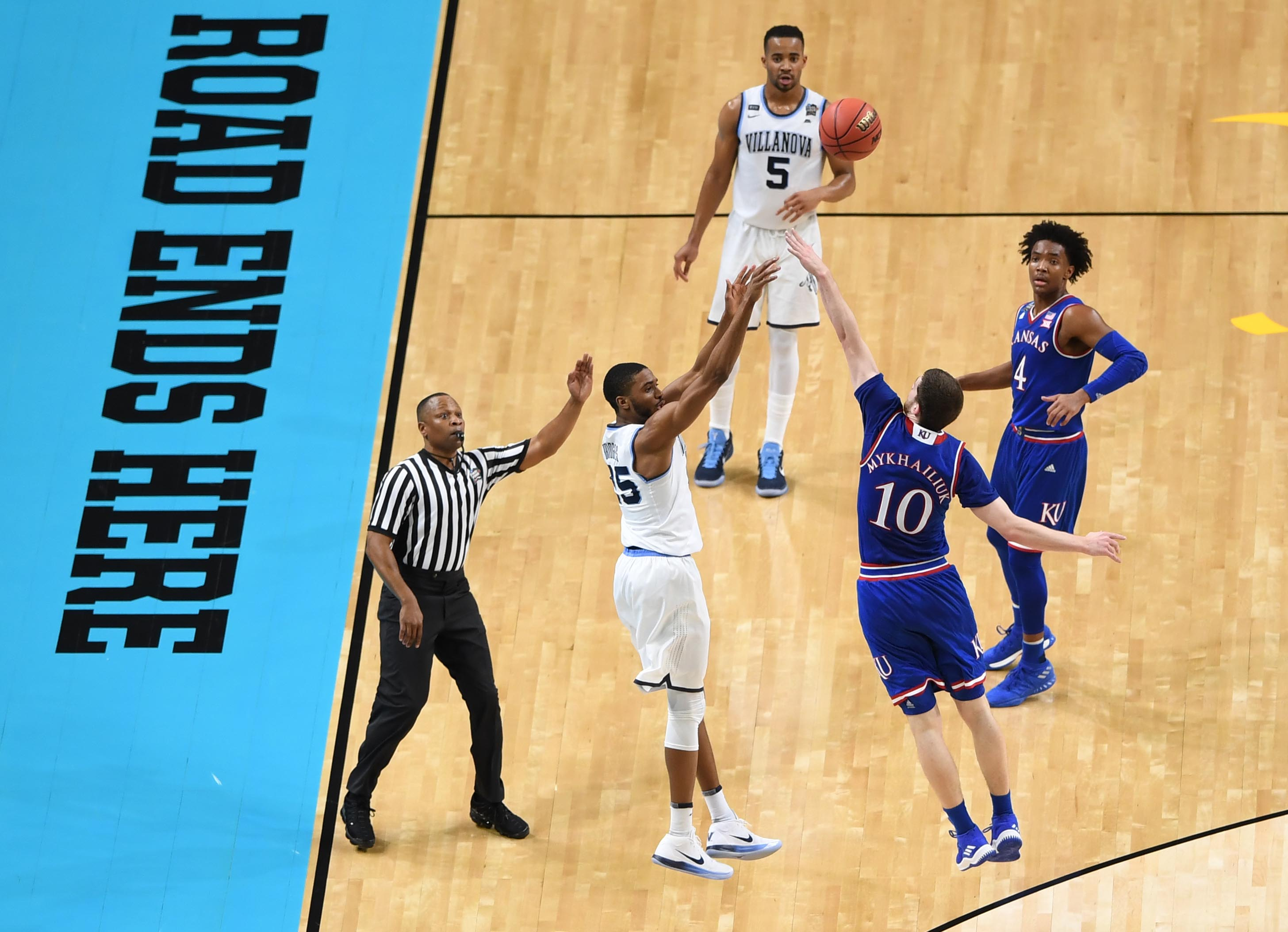 Mar 31, 2018; San Antonio, TX, United States; Villanova Wildcats guard Mikal Bridges (25) shoots a three pointer over Kansas Jayhawks guard Sviatoslav Mykhailiuk (10) in the first half in the semifinals of the 2018 men's Final Four at Alamodome. Mandatory Credit: Shanna Lockwood-USA TODAY Sports