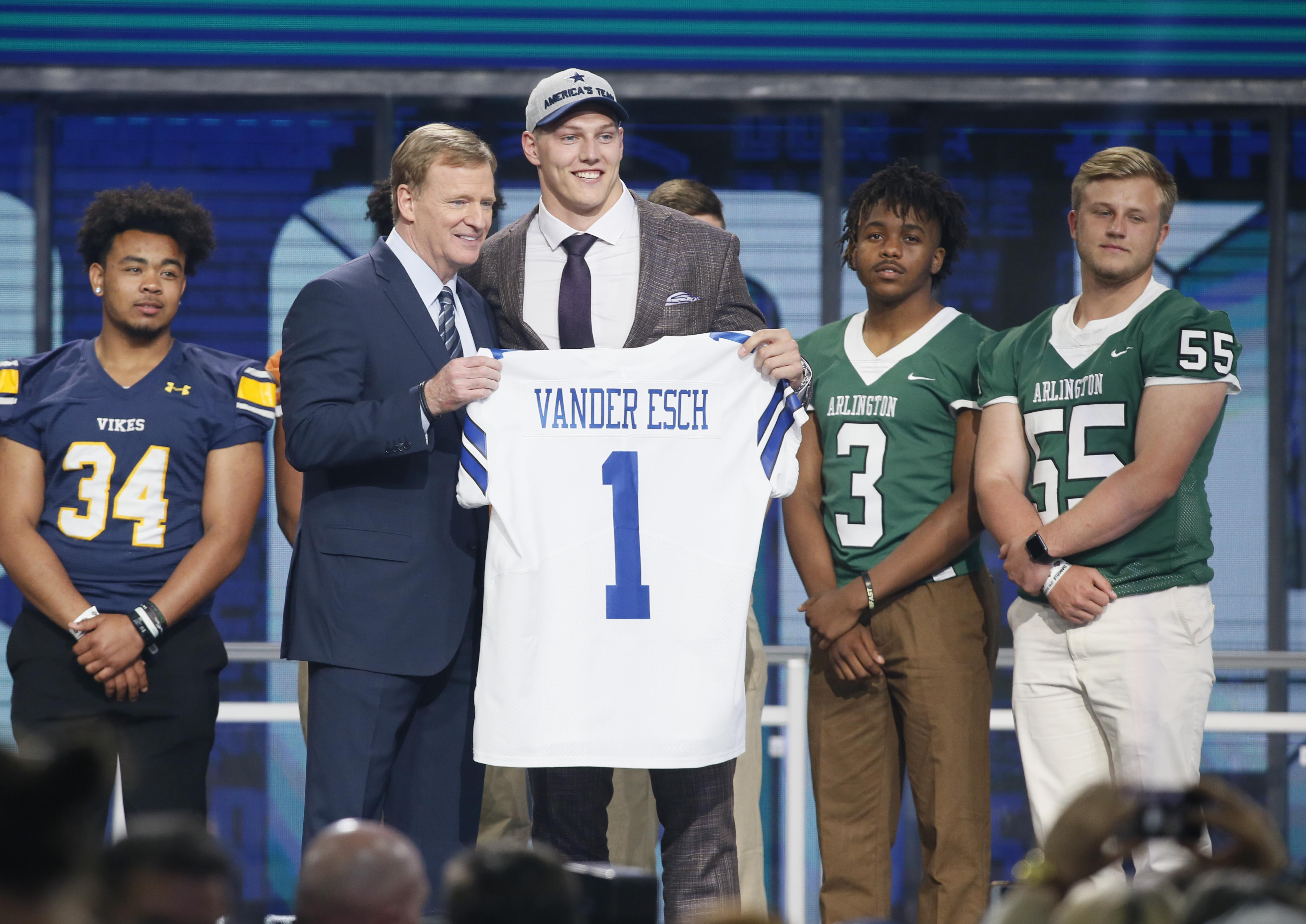Apr 26, 2018; Arlington, TX, USA; Leighton Vander Esch (Boise State) with NFL commissioner Roger Goodell after being selected as the number nineteen overall pick to the Dallas Cowboys in the first round of the 2018 NFL Draft at AT&T Stadium.  Mandatory Credit: Tim Heitman-USA TODAY Sports