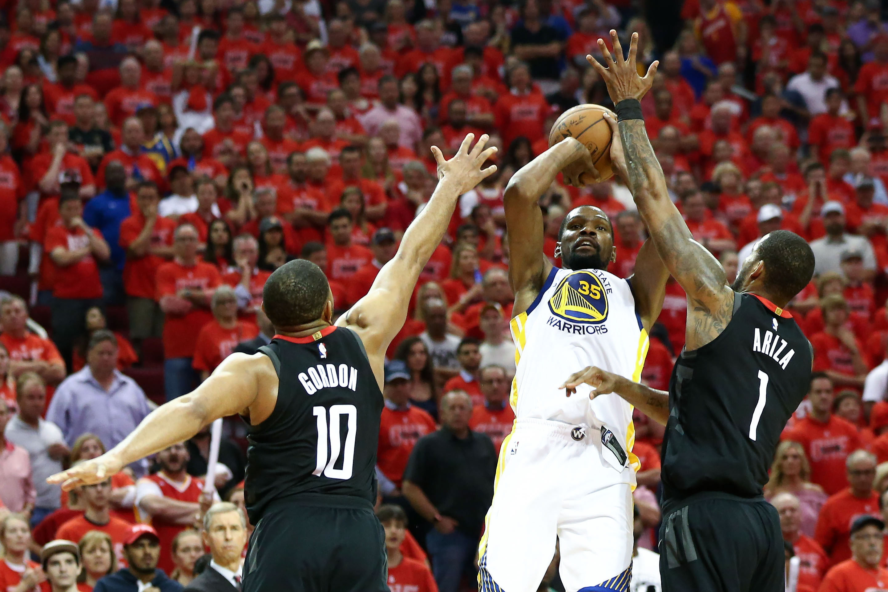 May 28, 2018; Houston, TX, USA; Golden State Warriors forward Kevin Durant (35) attempts a three point basket over Houston Rockets guard Eric Gordon (10) and forward Trevor Ariza (1) during the second half of game seven of the Western conference finals of the 2018 NBA Playoffs at Toyota Center. Mandatory Credit: Troy Taormina-USA TODAY Sports