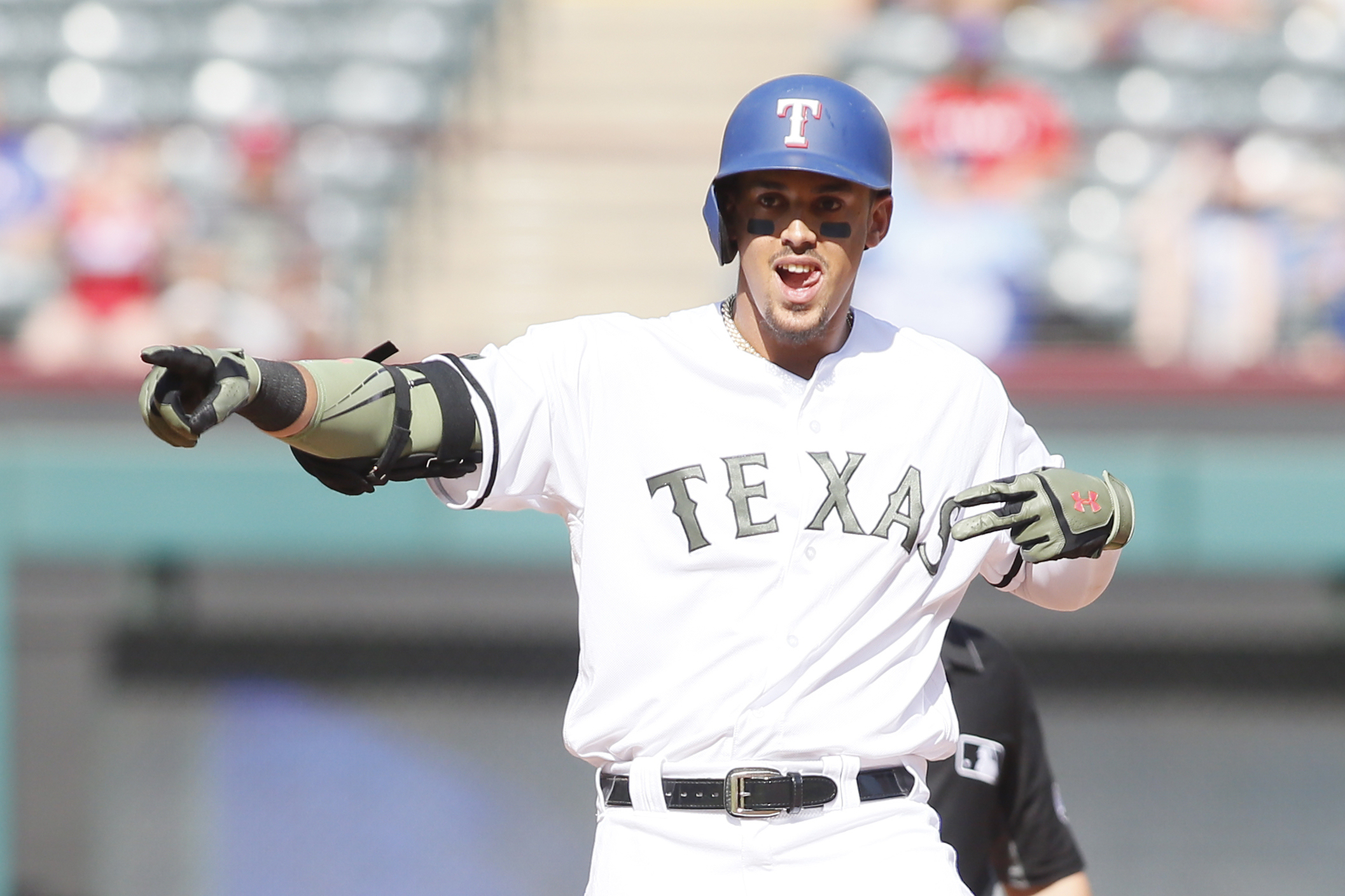 May 26, 2018; Arlington, TX, USA; Texas Rangers first baseman Ronald Guzman (67) reacts to driving in a run with a double in the sixth inning against the Kansas City Royals at Globe Life Park in Arlington. Mandatory Credit: Tim Heitman-USA TODAY Sports