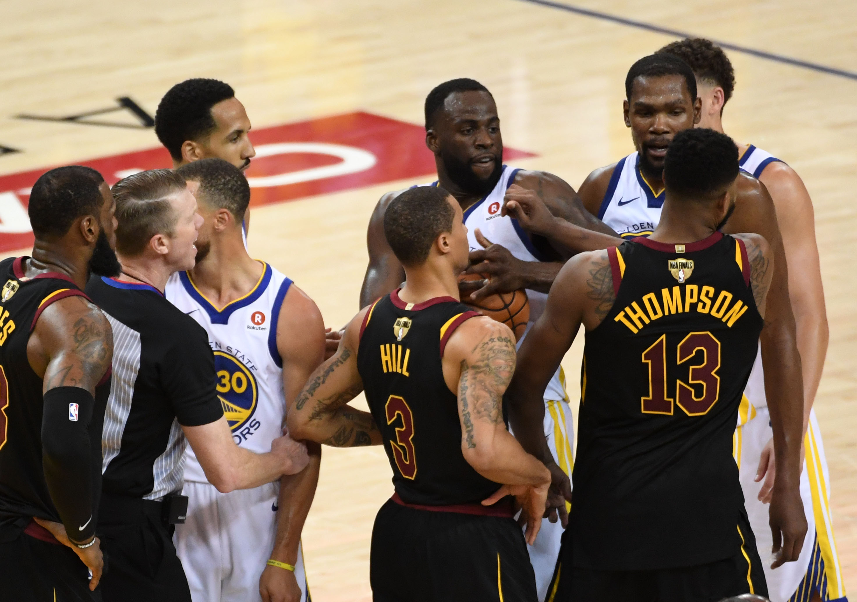 May 31, 2018; Oakland, CA, USA; Cleveland Cavaliers center Tristan Thompson (13) pushes Golden State Warriors forward Draymond Green (23) during overtime in game one of the 2018 NBA Finals at Oracle Arena. Mandatory Credit: Kyle Terada-USA TODAY Sports