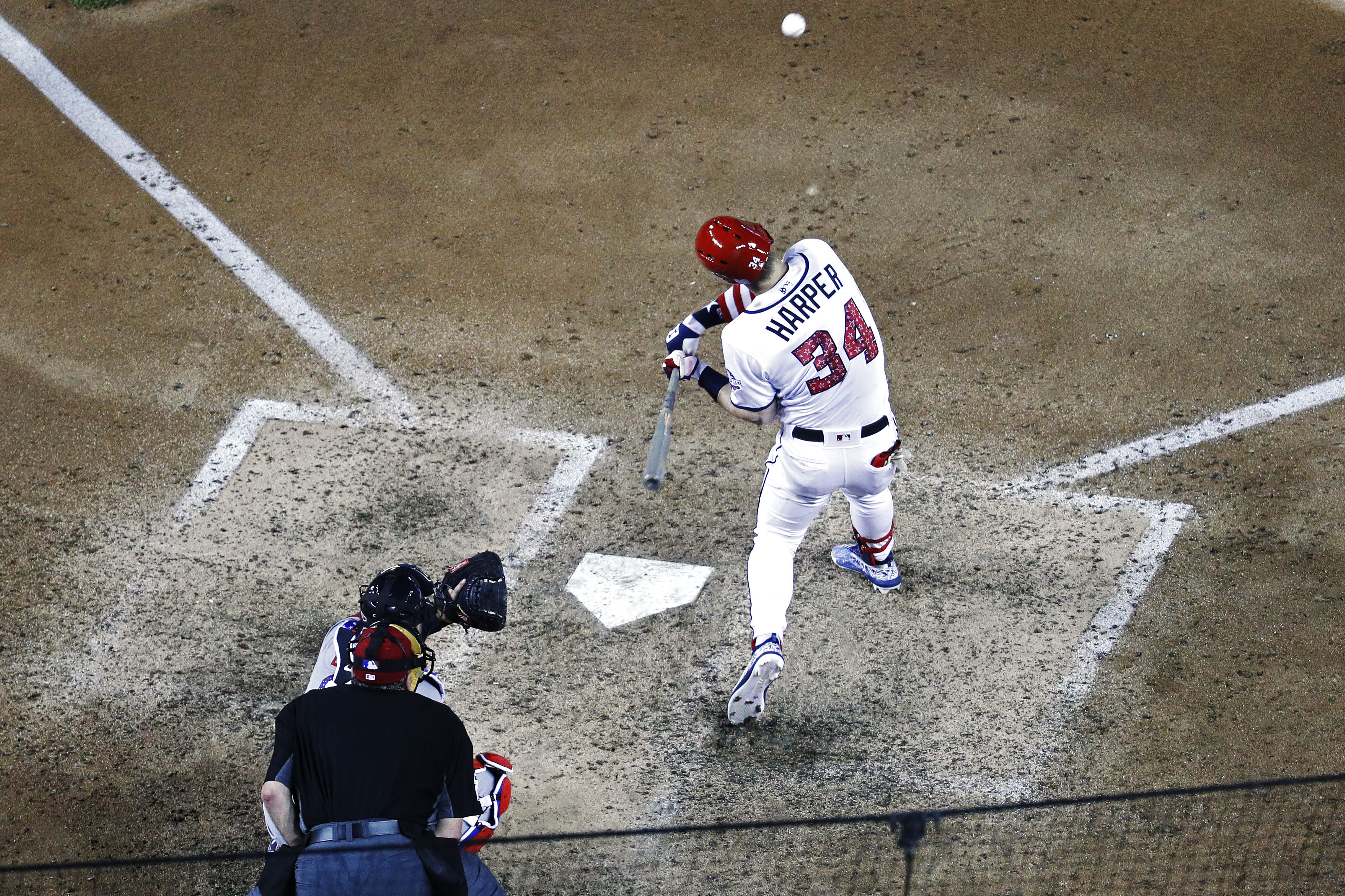 Jul 2, 2018; Washington, DC, USA; Washington Nationals right fielder Bryce Harper (34) hits a solo home run against the Boston Red Sox in the eighth inning at Nationals Park. Mandatory Credit: Geoff Burke-USA TODAY Sports
