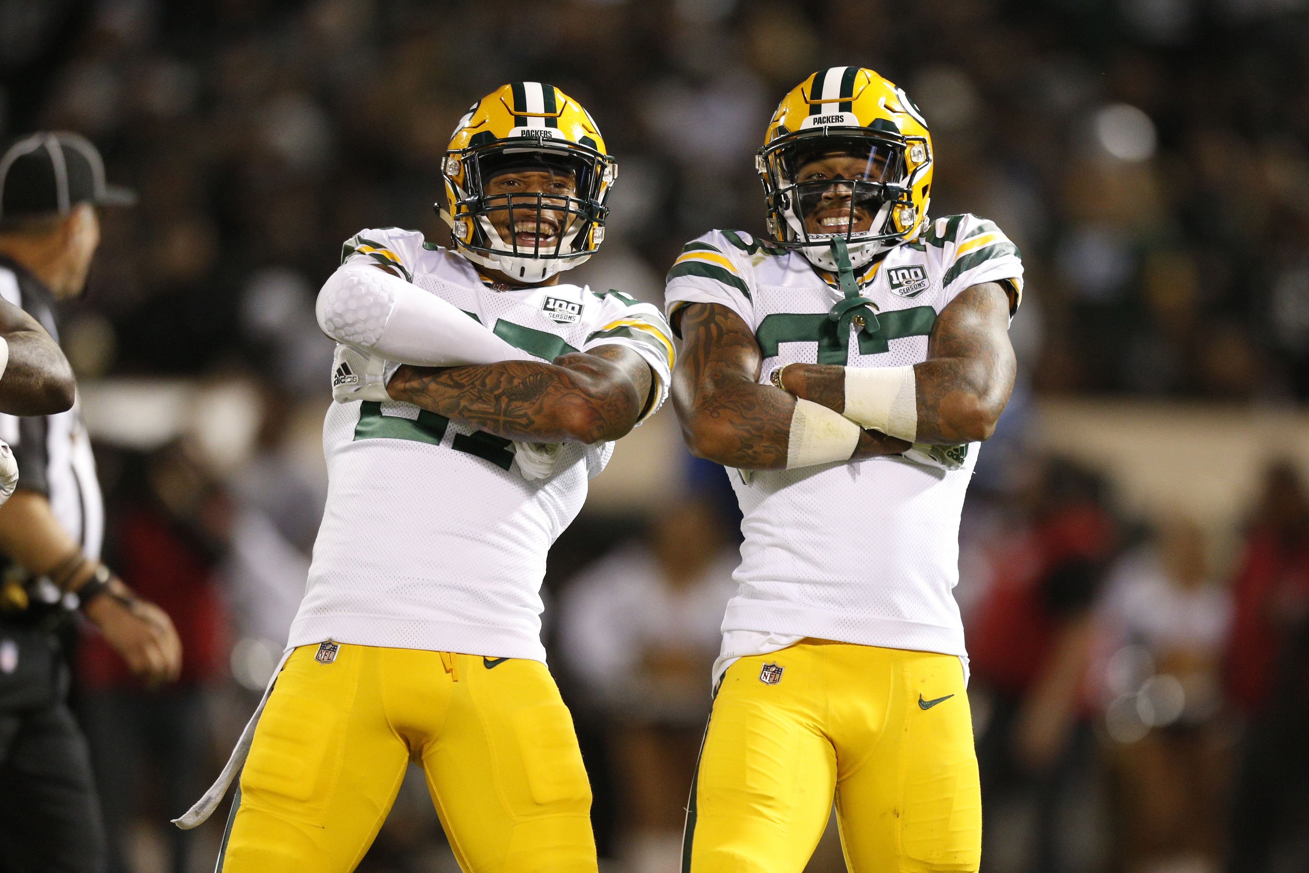 Aug 24, 2018; Oakland, CA, USA; Green Bay Packers cornerback Jaire Alexander (23) celebrates with safety Josh Jones (27) after intercepting a pass against the Oakland Raiders in the second quarter at Oakland Coliseum. Mandatory Credit: Cary Edmondson-USA TODAY Sports