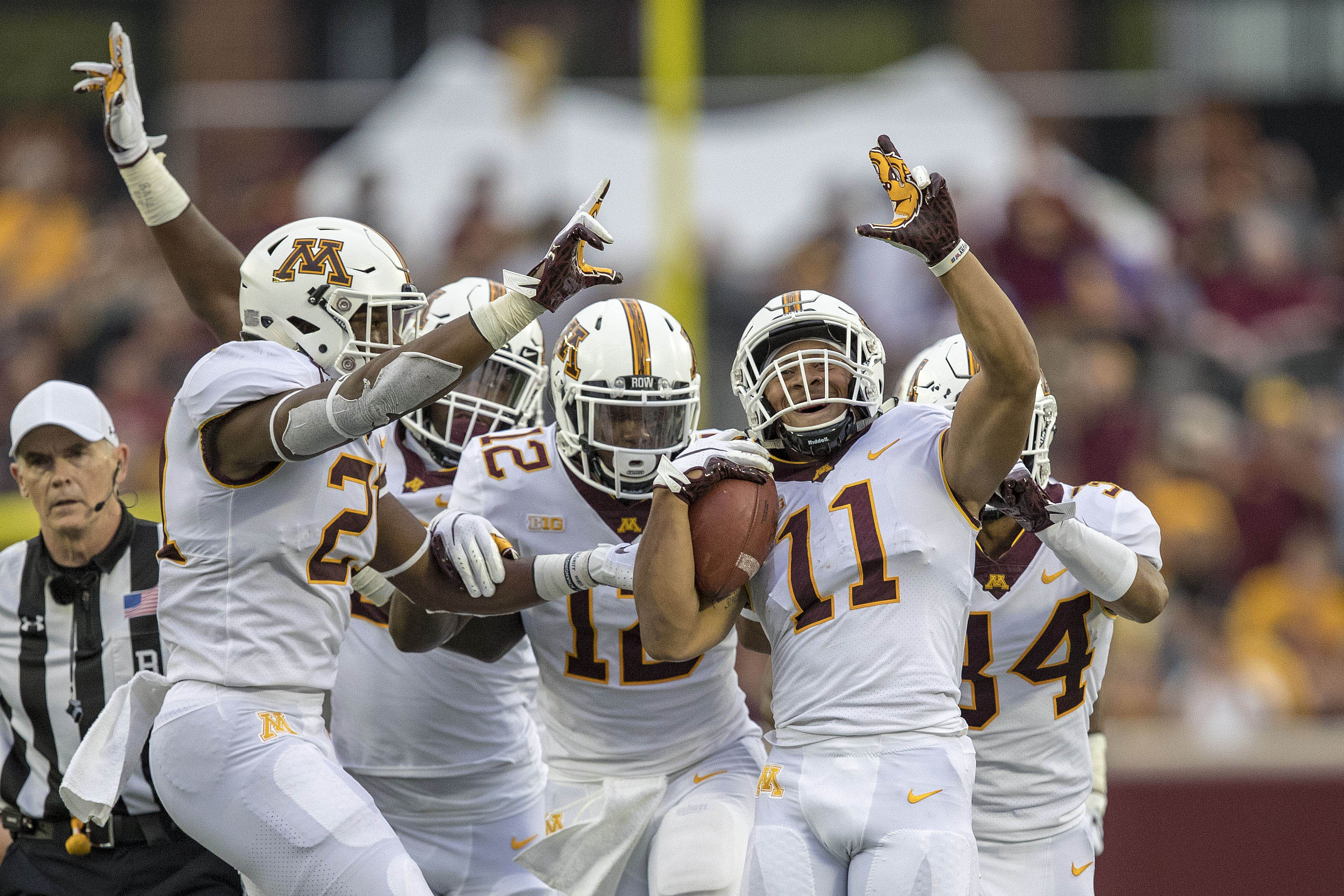 Aug 30, 2018; Minneapolis, MN, USA; Minnesota Golden Gophers defensive back Antoine Winfield Jr. (11) celebrates after intercepting a pass in the first half against the New Mexico State Aggies at TCF Bank Stadium. Mandatory Credit: Jesse Johnson-USA TODAY Sports