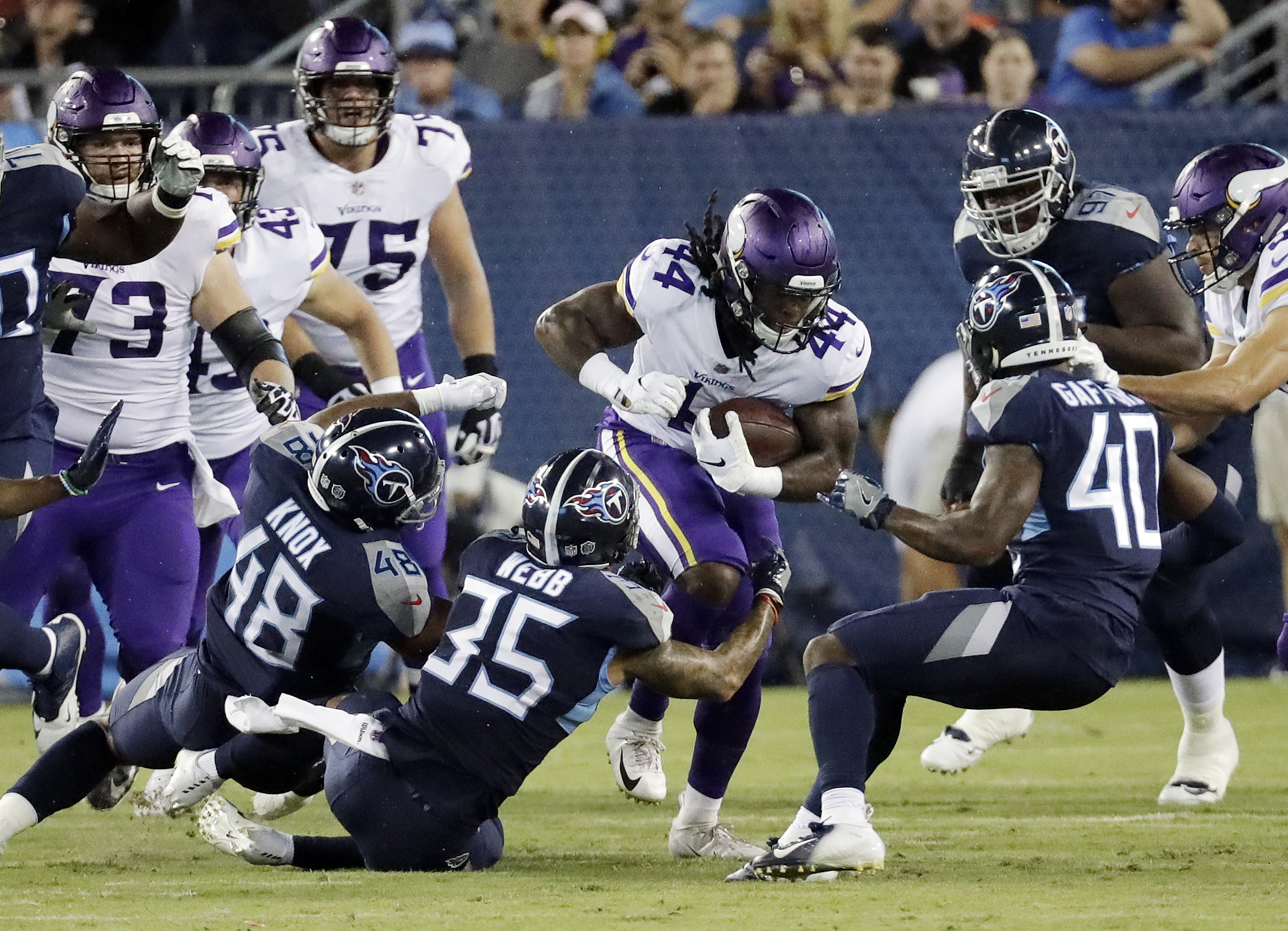 Minnesota Vikings running back Mike Boone (44) carries the ball against the Tennessee Titans in the first half of a preseason NFL football game Thursday, Aug. 30, 2018, in Nashville, Tenn. (AP Photo/James Kenney)