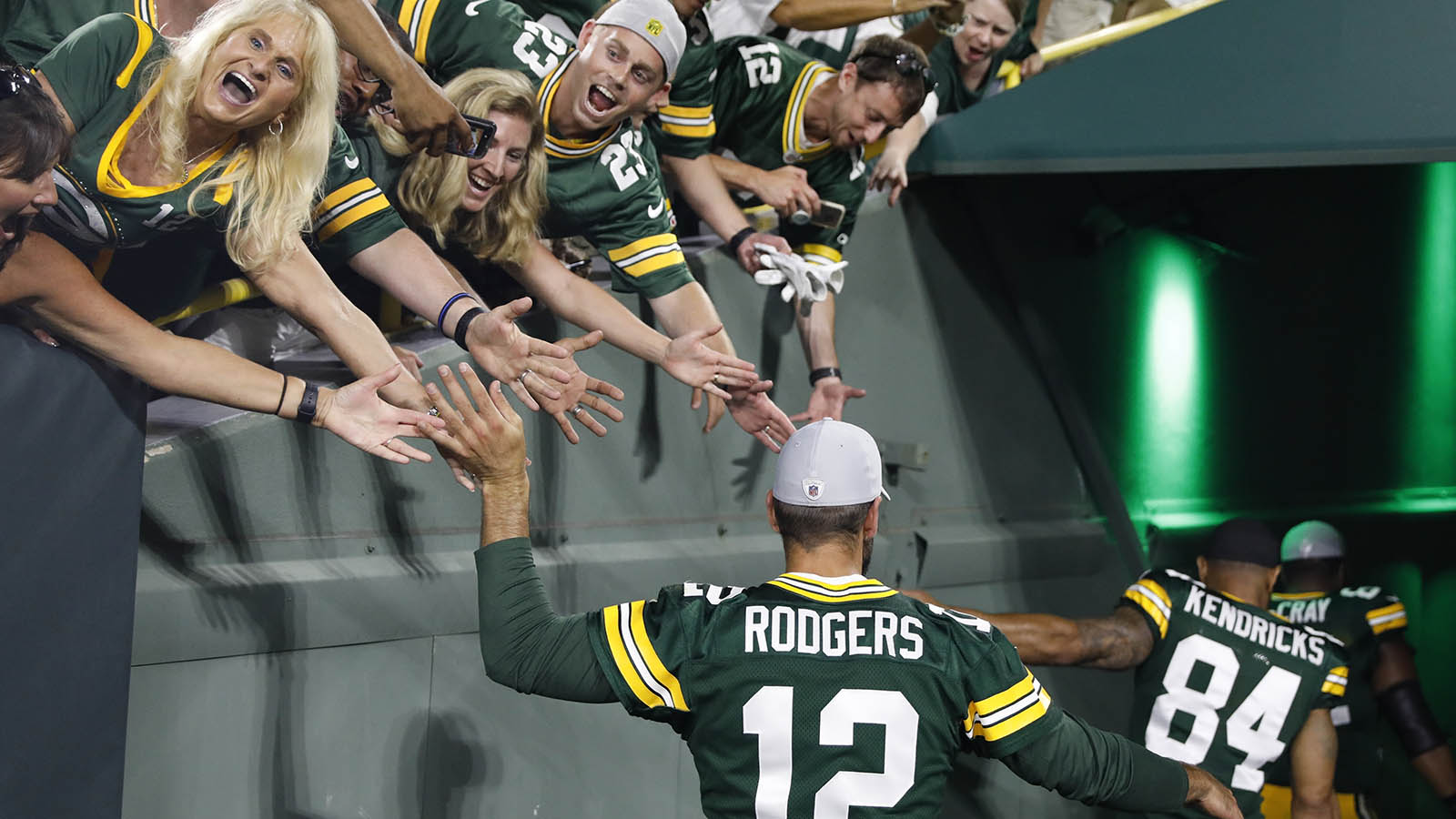 Fan high five Green Bay Packers' Aaron Rodgers after a preseason NFL football game against the Pittsburgh Steelers Thursday, Aug. 16, 2018, in Green Bay, Wis. The Packers won 51-34. (AP Photo/Jeffrey Phelps)