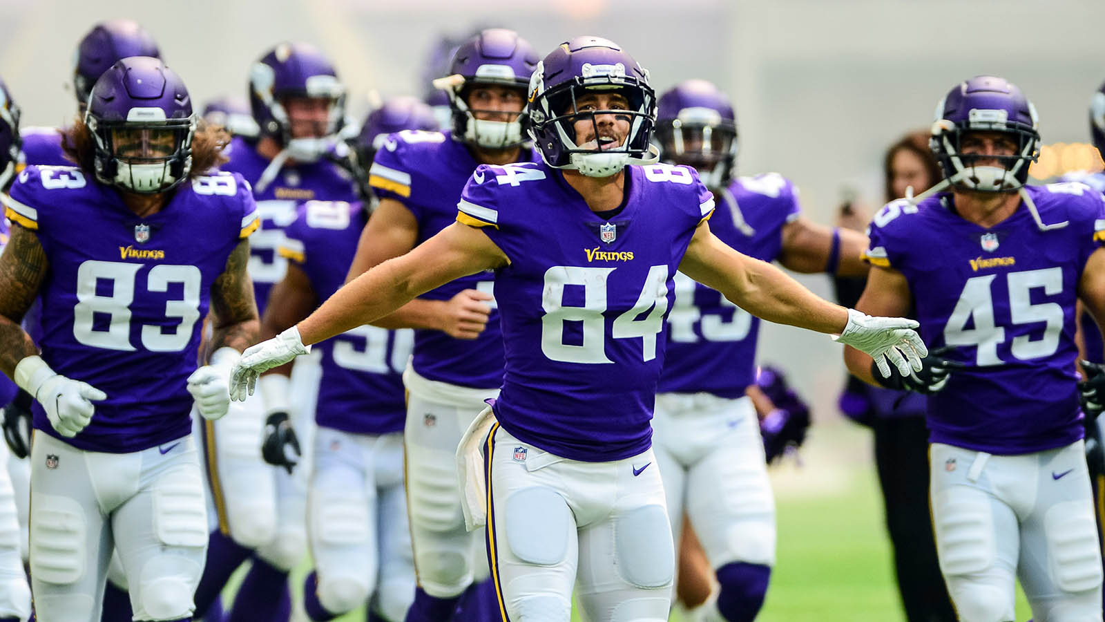 Aug 18, 2018; Minneapolis, MN, USA; Minnesota Vikings wide receiver Chad Beebe (84) leads the Vikings onto the field against the Jacksonville Jaguars before the game at U.S. Bank Stadium. Mandatory Credit: Jeffrey Becker-USA TODAY Sports