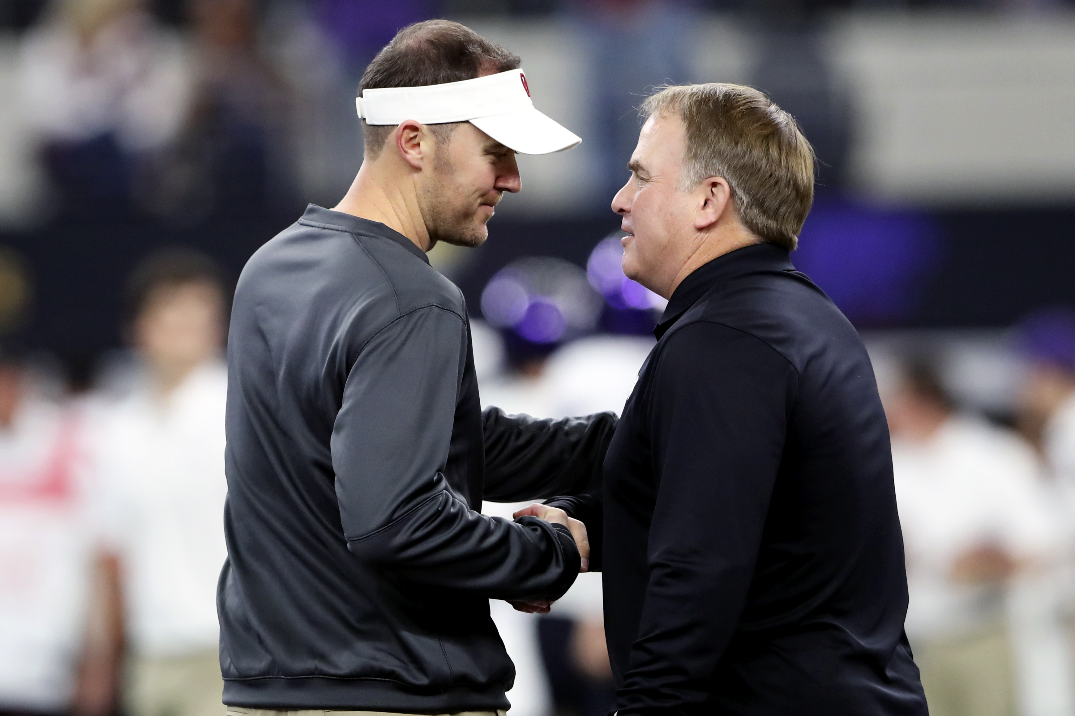 Dec 2, 2017; Arlington, TX, USA; Oklahoma Sooners head coach Lincoln Riley (left) shakes hands with TCU Horned Frogs head coach Gary Patterson (right) before the the Big 12 Championship game at AT&T Stadium. Mandatory Credit: Kevin Jairaj-USA TODAY Sports