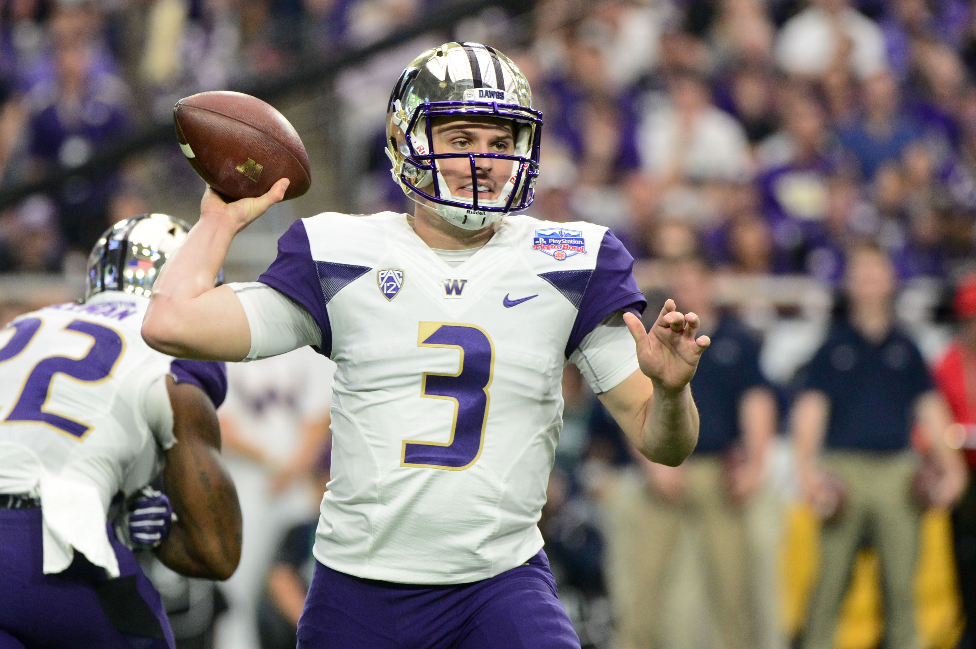 Dec 30, 2017; Glendale, AZ, USA; Washington Huskies quarterback Jake Browning (3) throws a pass during the first half against the Penn State Nittany Lions during the 2017 Fiesta Bowl at University of Phoenix Stadium. Mandatory Credit: Matt Kartozian-USA TODAY Sports