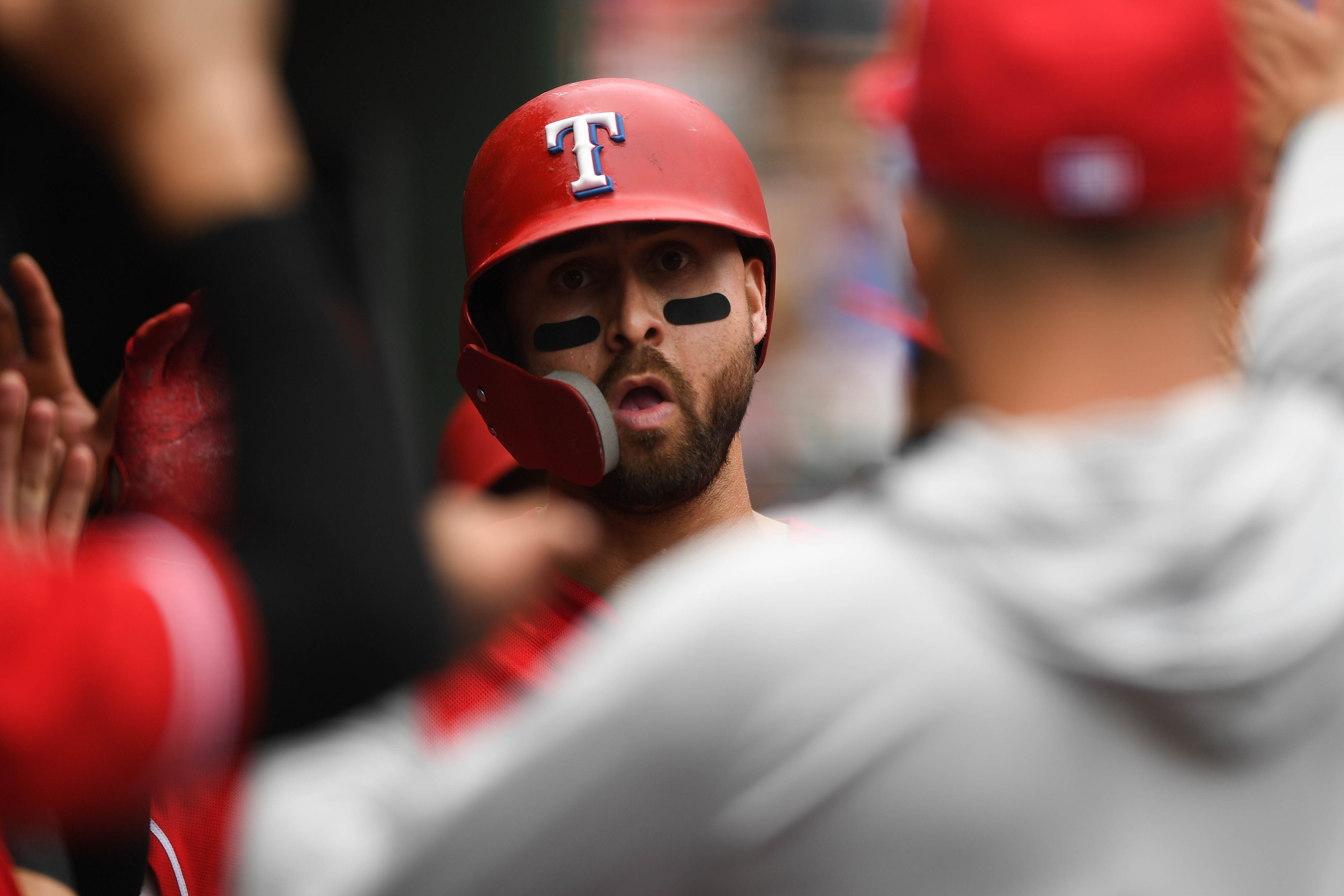 Aug 8, 2018; Arlington, TX, USA; Texas Rangers third baseman Joey Gallo (13) celebrates his home run with teammates in the dugout during the third inning against the Seattle Mariners at Globe Life Park in Arlington. Mandatory Credit: Shanna Lockwood-USA TODAY Sports