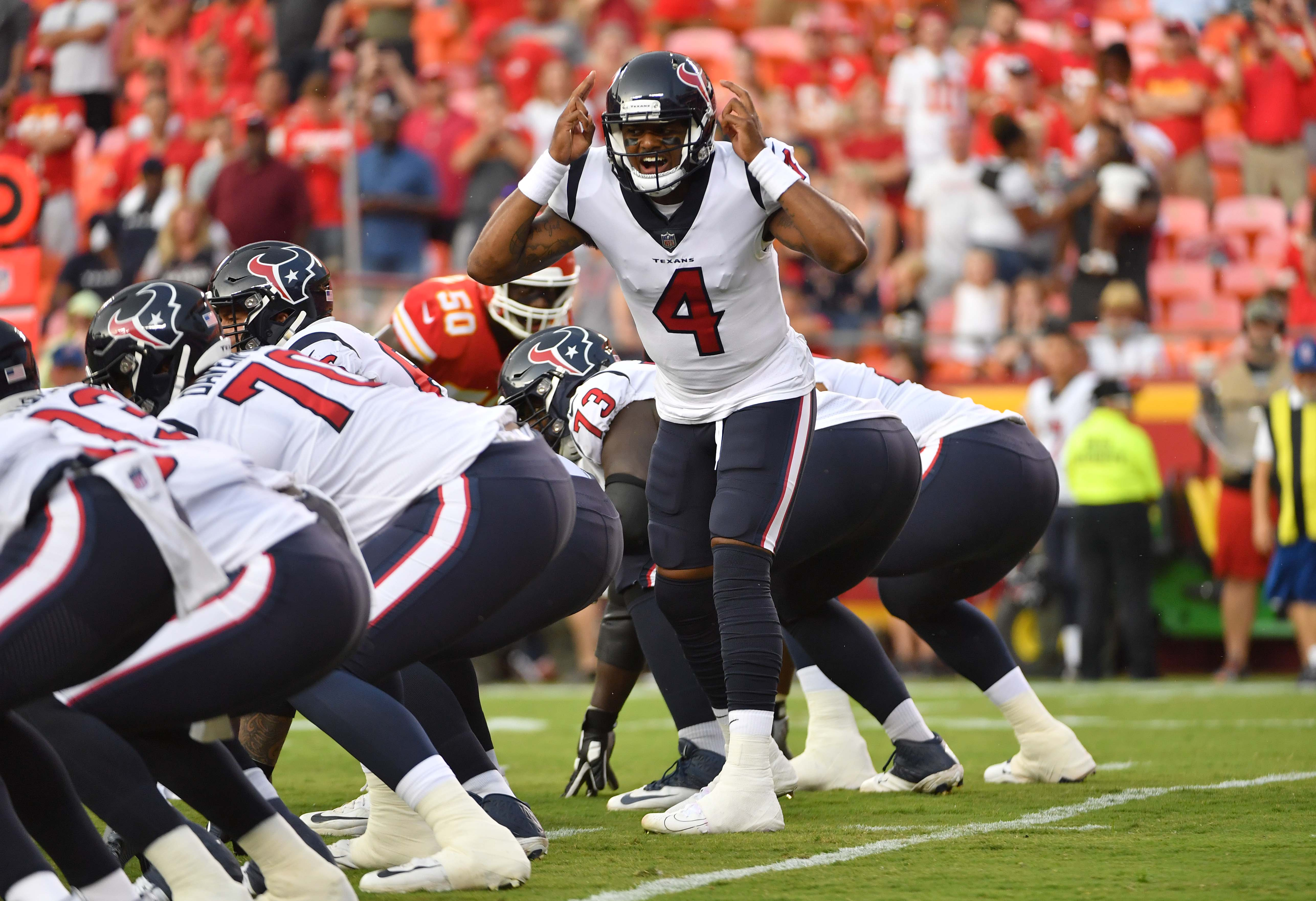 Aug 9, 2018; Kansas City, MO, USA; Houston Texans quarterback Deshaun Watson (4) motions on the line of scrimmage during the first half against the Kansas City Chiefs at Arrowhead Stadium. Mandatory Credit: Denny Medley-USA TODAY Sports