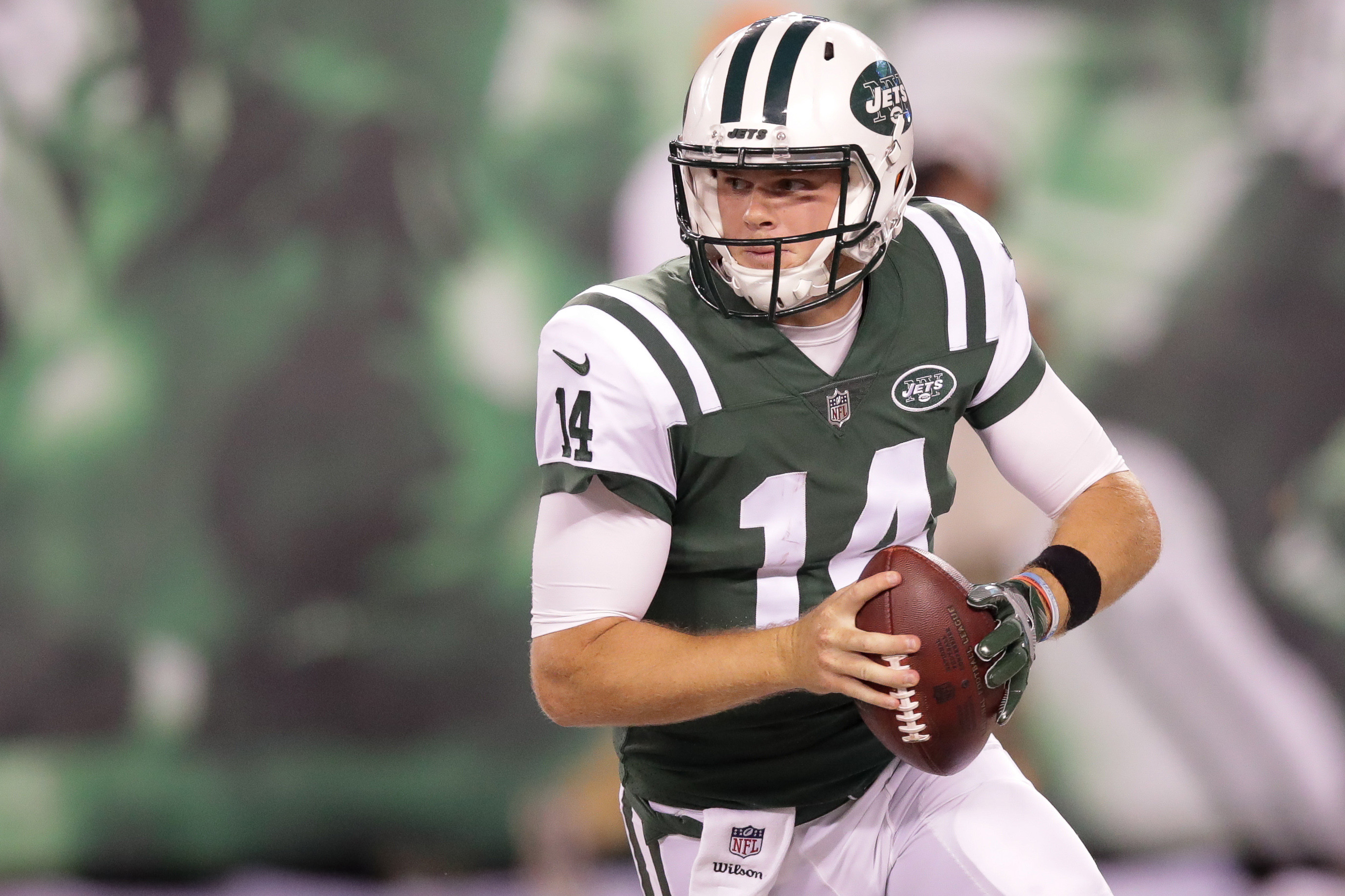 Aug 10, 2018; East Rutherford, NJ, USA; New York Jets quarterback Sam Darnold (14) rolls out during the second half against the Atlanta Falcons at MetLife Stadium. Mandatory Credit: Vincent Carchietta-USA TODAY Sports