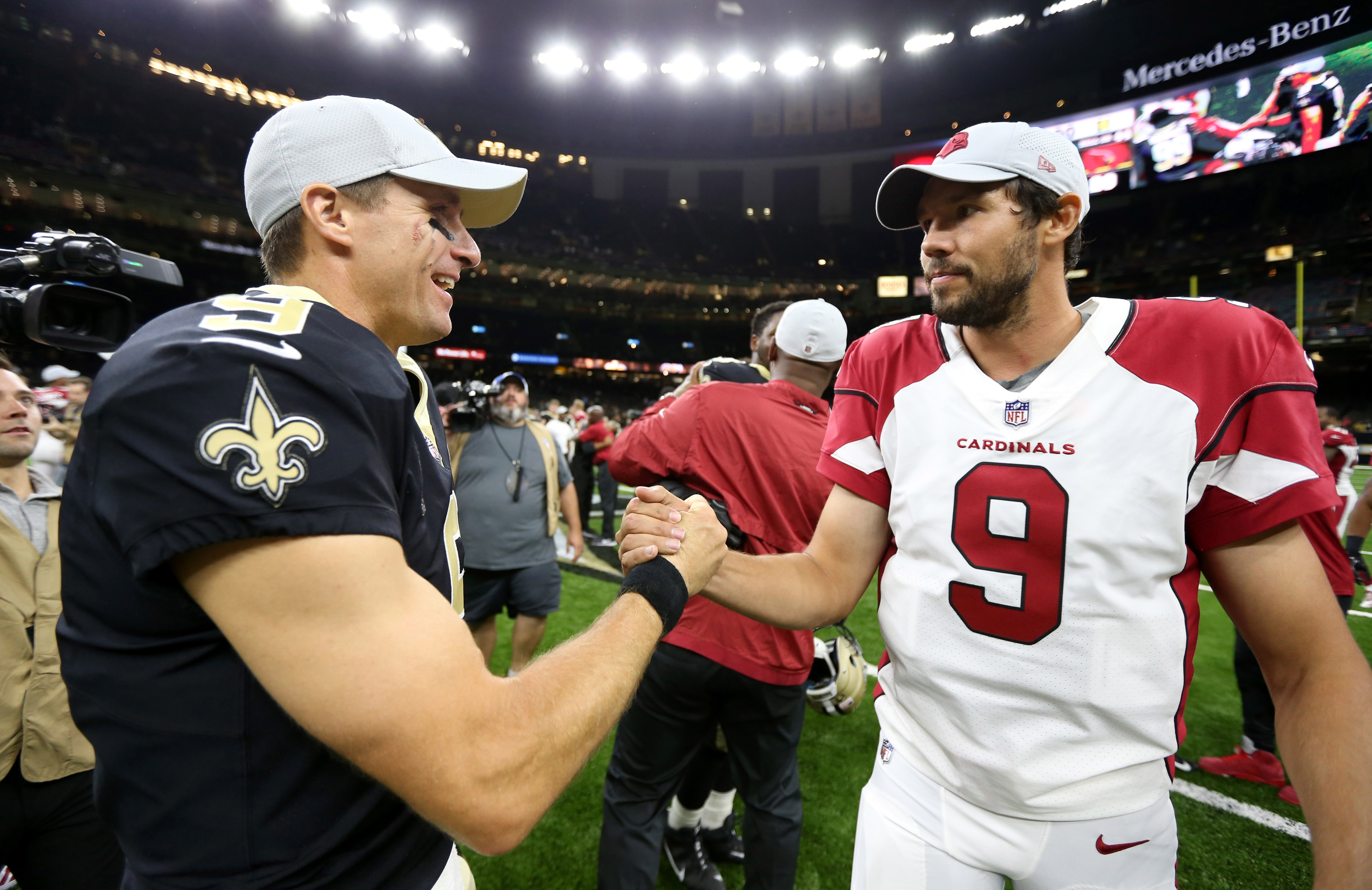 Aug 17, 2018; New Orleans, LA, USA; New Orleans Saints quarterback Drew Brees (9) and Arizona Cardinals quarterback Sam Bradford (9) talk after their game at the Mercedes-Benz Superdome. Mandatory Credit: Chuck Cook-USA TODAY Sports
