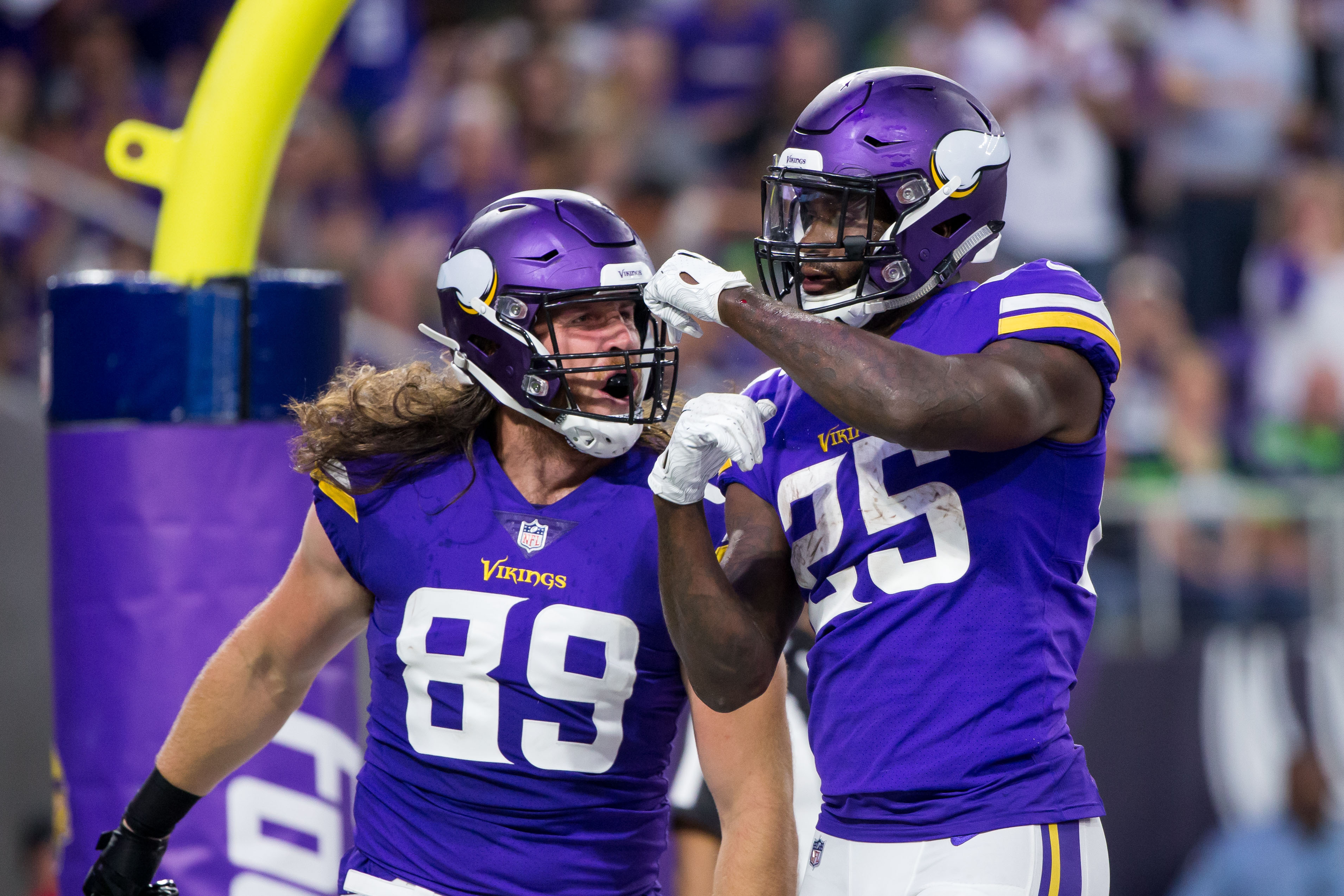 Aug 24, 2018; Minneapolis, MN, USA; Minnesota Vikings running back Latavius Murray (25) celebrates his touchdown with tight end David Morgan (89) in the second quarter against Seattle Seahawks at U.S. Bank Stadium. Mandatory Credit: Brad Rempel-USA TODAY Sports