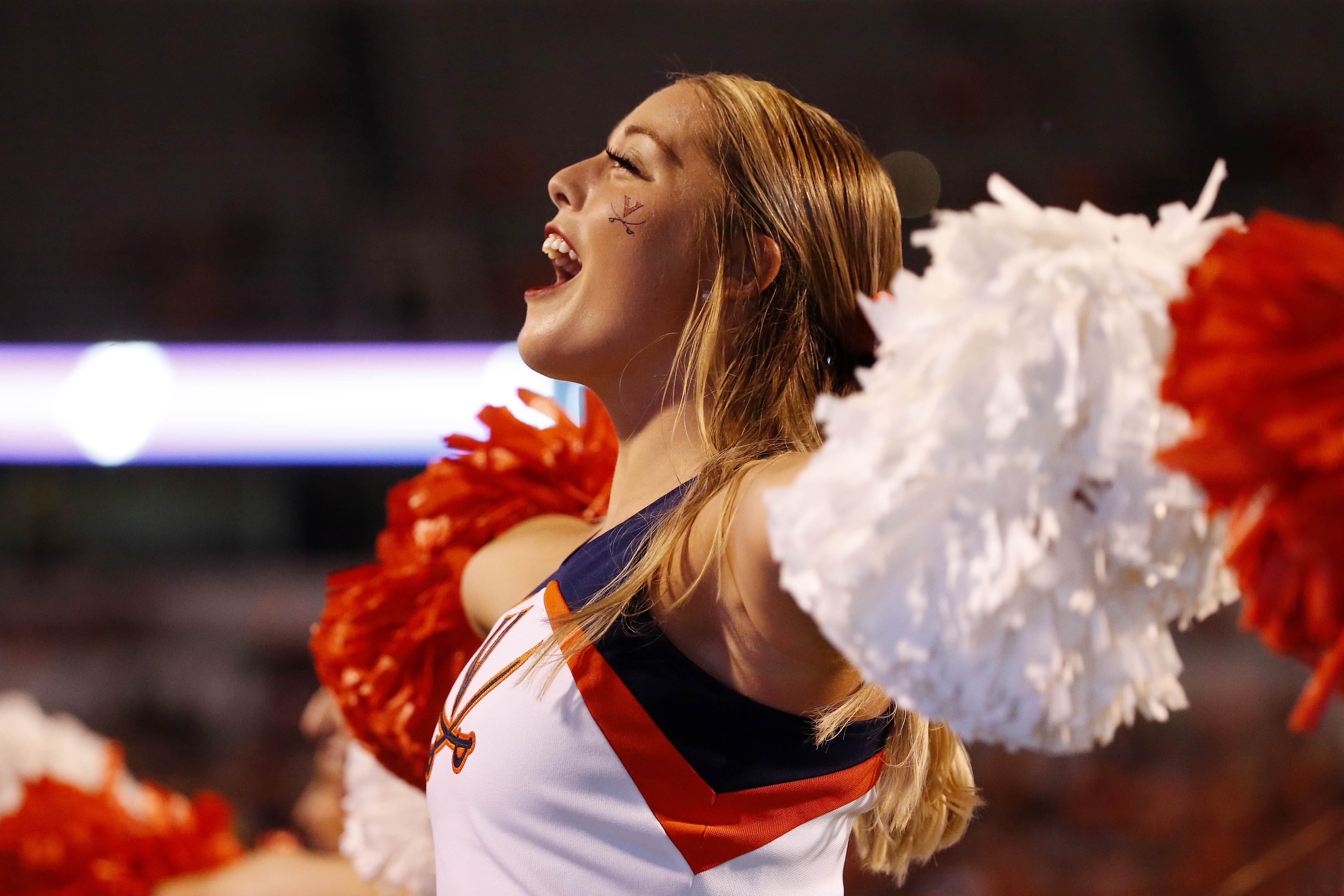Sep 1, 2018; Charlottesville, VA, USA; A Virginia Cavaliers cheerleader yells from the sidelines during the second quarter against the Richmond Spiders at Scott Stadium. Mandatory Credit: Amber Searls-USA TODAY Sports
