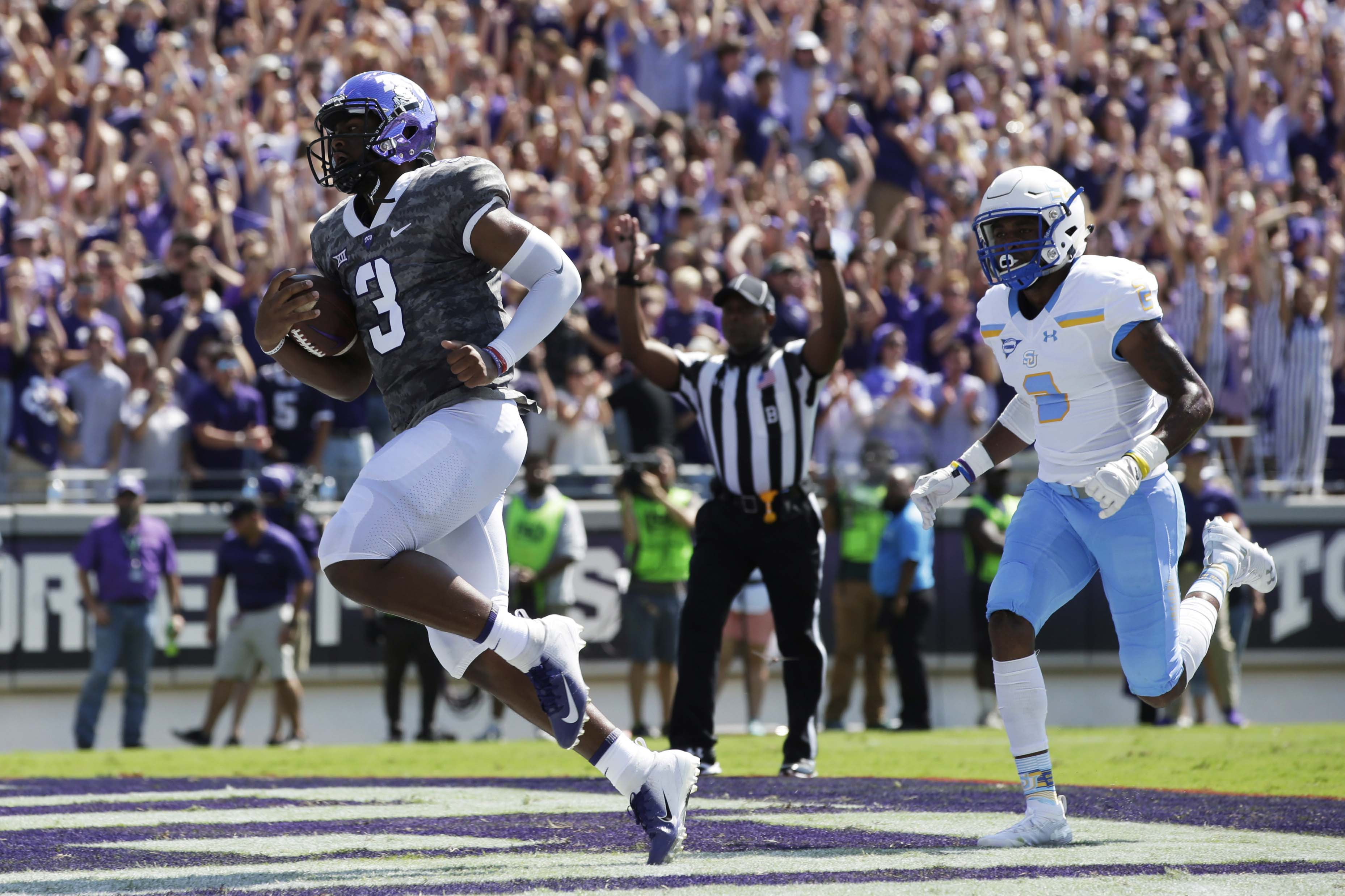 Sep 1, 2018; Fort Worth, TX, USA; TCU Horned Frogs quarterback Shawn Robinson (3) scores a touchdown in the first quarter against the Southern University Jaguars at Amon G. Carter Stadium. Mandatory Credit: Tim Heitman-USA TODAY Sports