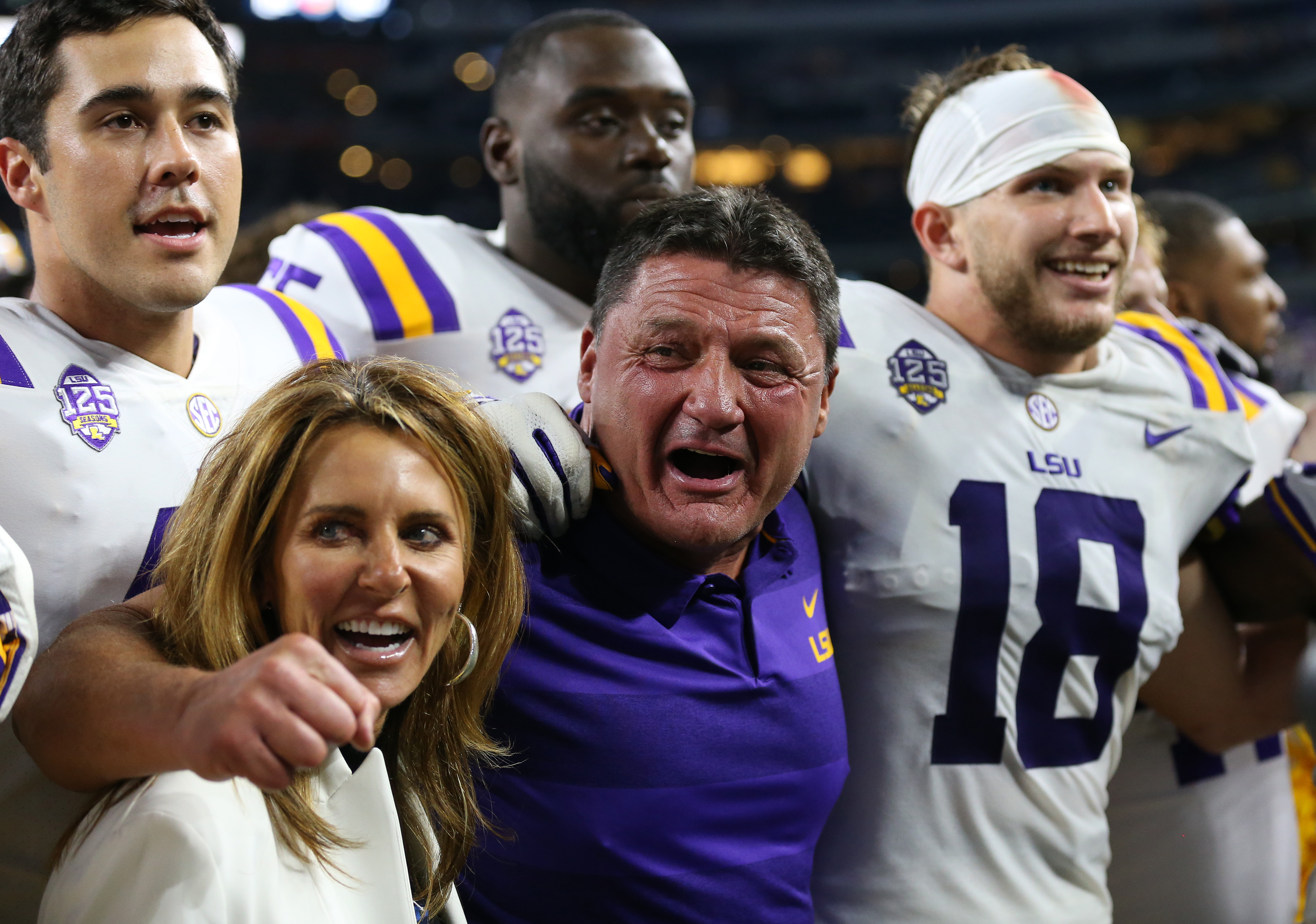 Sep 2, 2018; Arlington, TX, USA; LSU Tigers head coach Ed Orgeron celebrates with his team after a victory against the Miami Hurricanes at AT&T Stadium. Mandatory Credit: Matthew Emmons-USA TODAY Sports