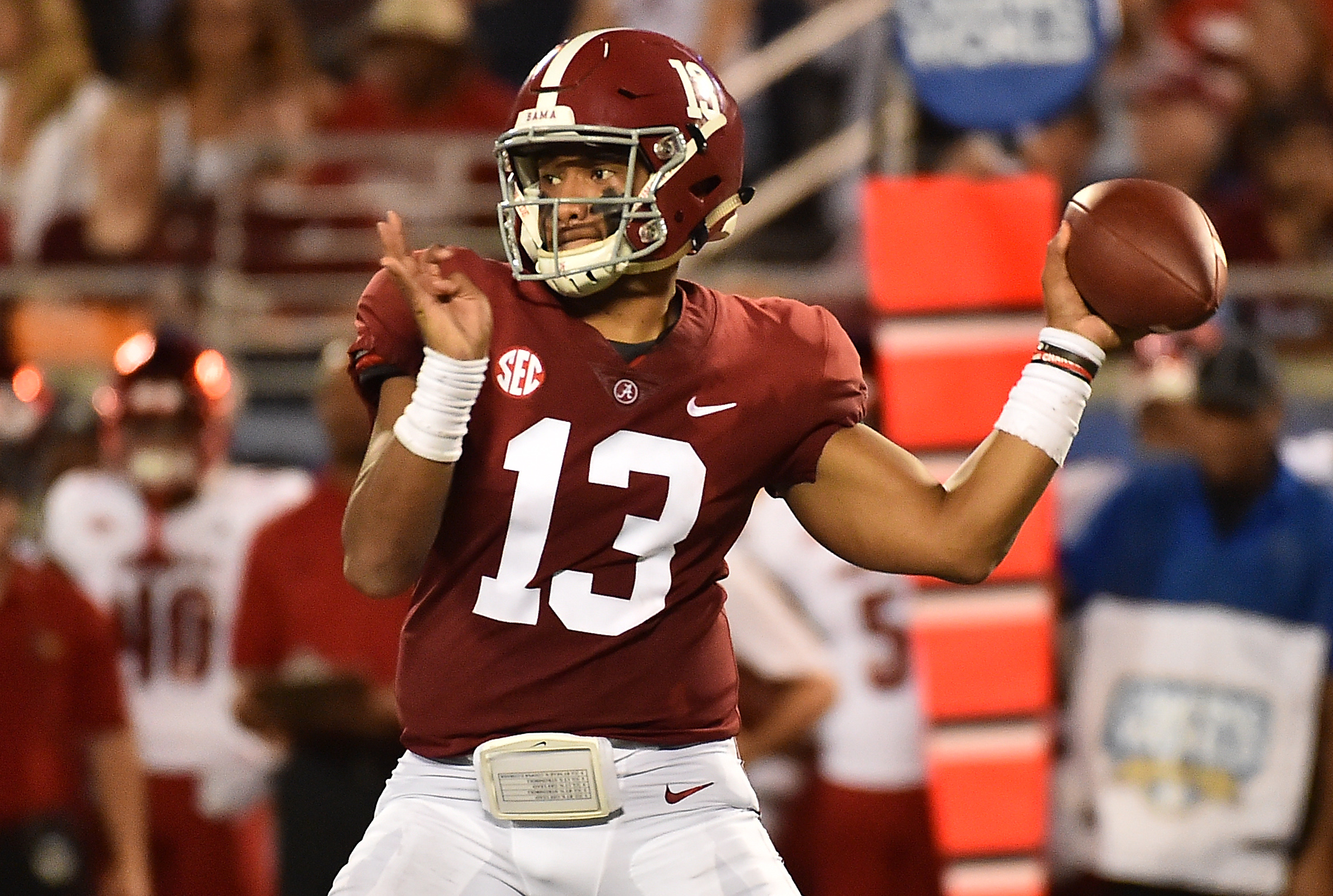 Sep 1, 2018; Orlando, FL, USA; Alabama Crimson Tide quarterback Tua Tagovailoa (13) attempts a pass against the Louisville Cardinals during the first half at Camping World Stadium. Mandatory Credit: Jasen Vinlove-USA TODAY Sports