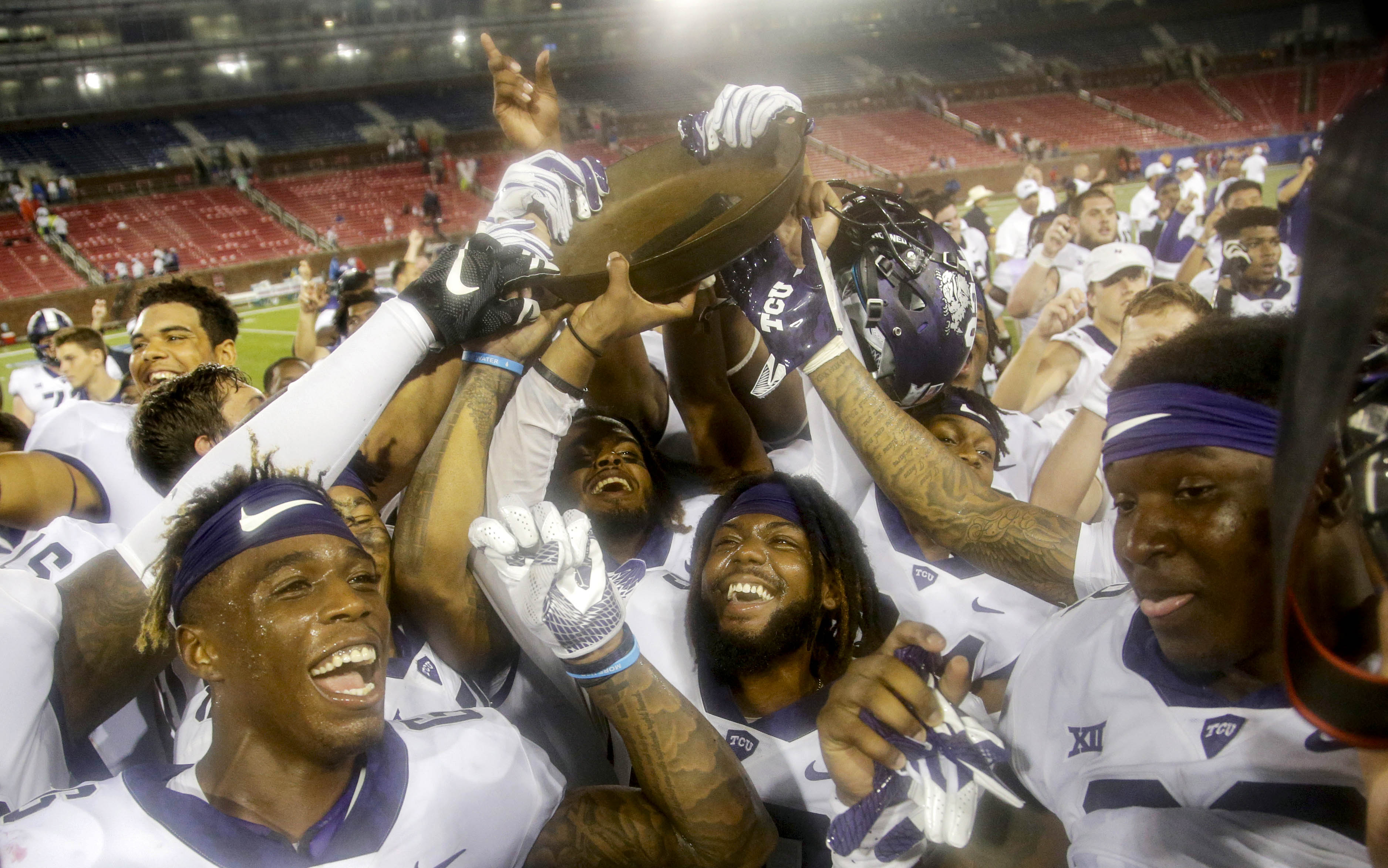 Sep 7, 2018; Dallas, TX, USA; TCU Horned Frogs players hold up the Iron Skillet after the game against the Southern Methodist Mustangs at Gerald J. Ford Stadium. Mandatory Credit: Tim Heitman-USA TODAY Sports