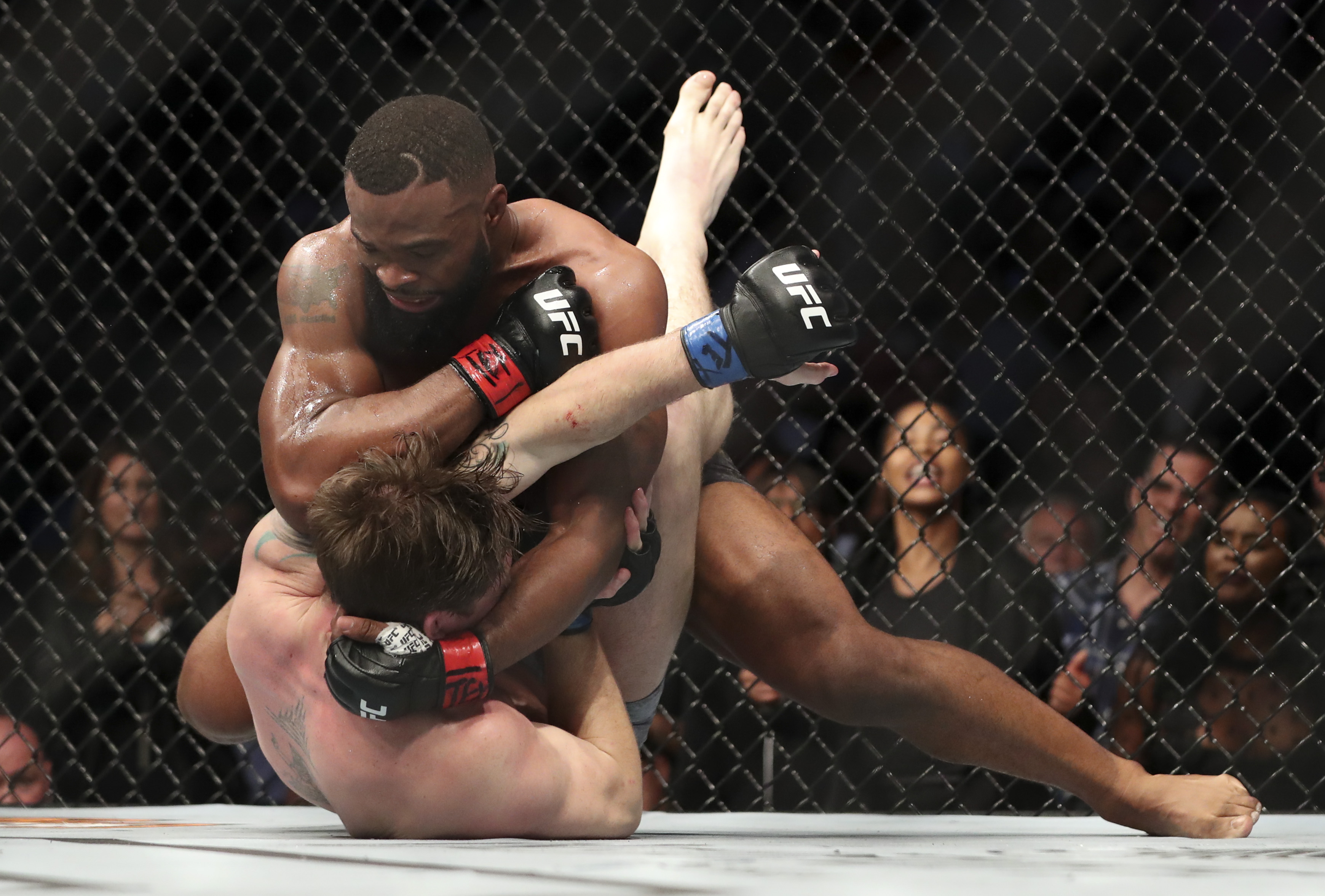Sep 8, 2018; Dallas, TX, USA; Tyron Woodley (red gloves) fights Darren Till (blue gloves) during UFC 228 at American Airlines Center. Mandatory Credit: Kevin Jairaj-USA TODAY Sports