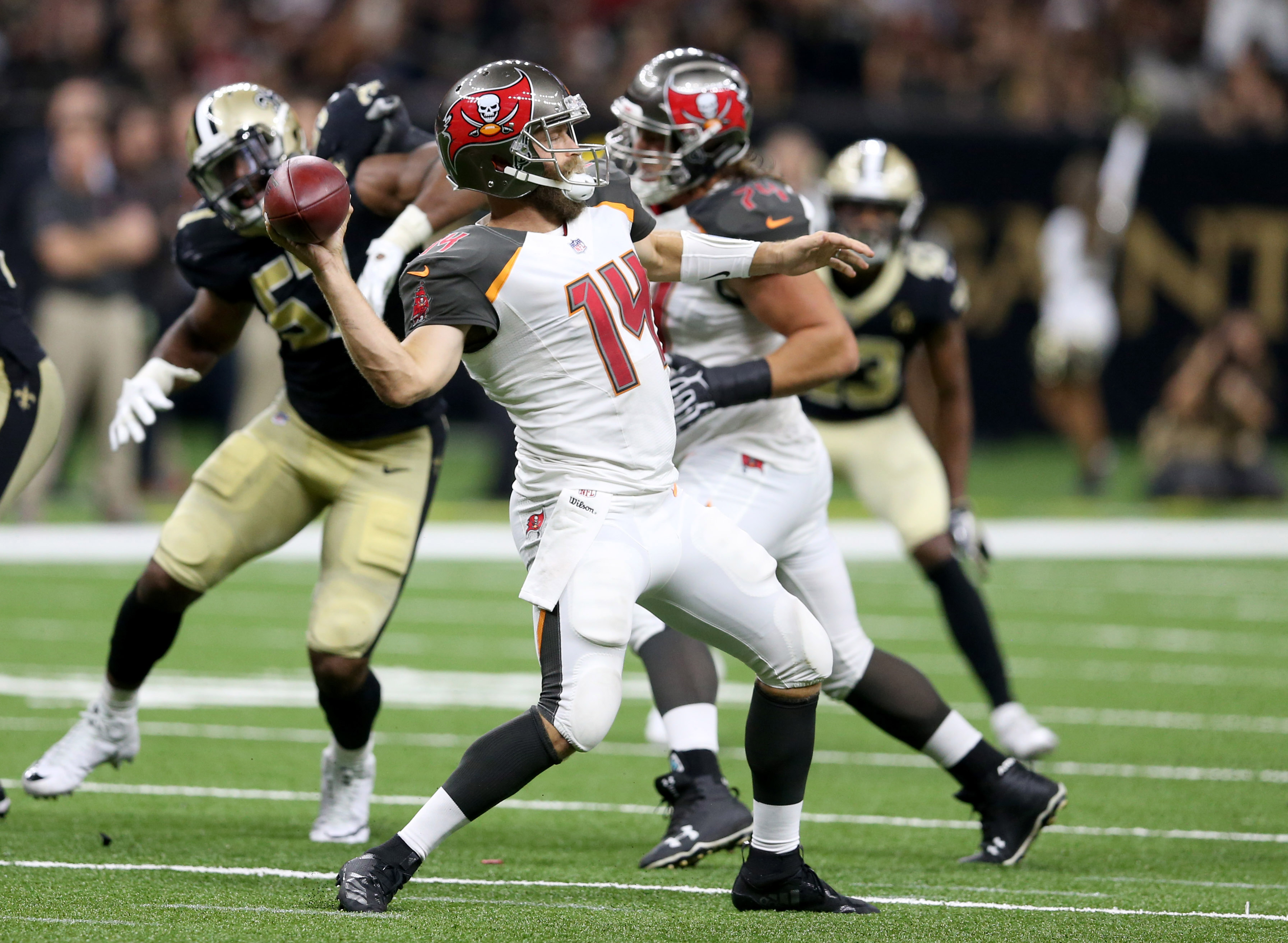 Sep 9, 2018; New Orleans, LA, USA; Tampa Bay Buccaneers quarterback Ryan Fitzpatrick (14) throws deep against the New Orleans Saints in the second half at the Mercedes-Benz Superdome. The Bucs won, 48-40. Mandatory Credit: Chuck Cook-USA TODAY Sports